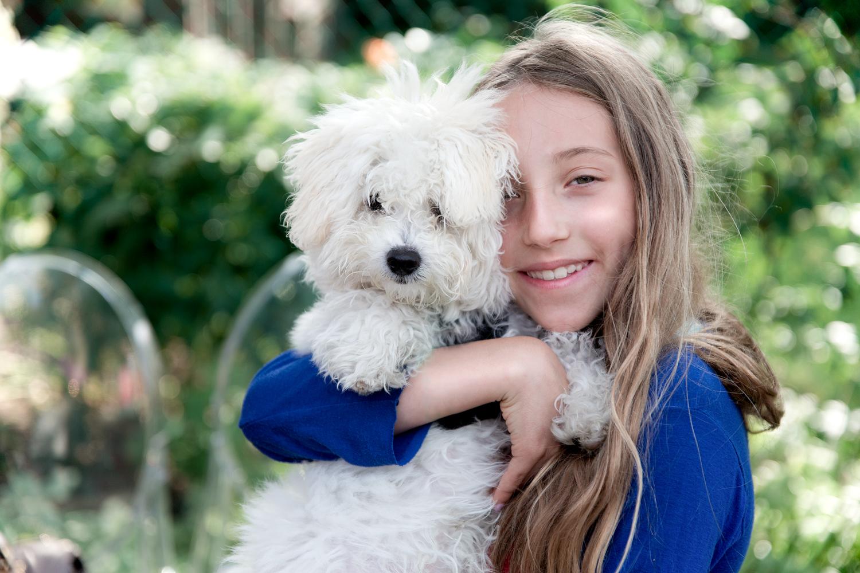 Girl hugs dog Toronto dog photographers