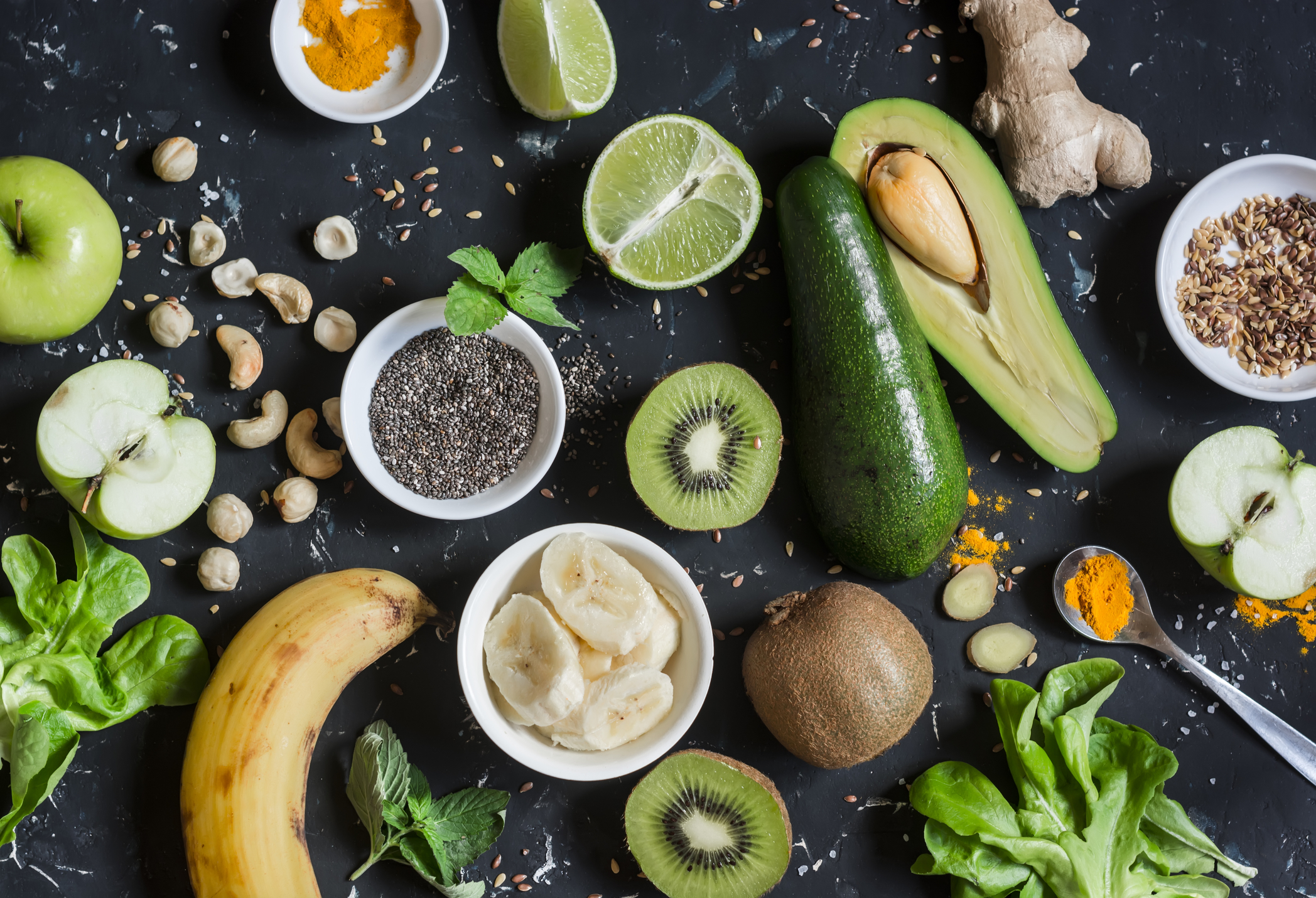 green-smoothie-ingredients-cooking-healthy-detox-smoothies-on-a-dark-background-79832057.jpg