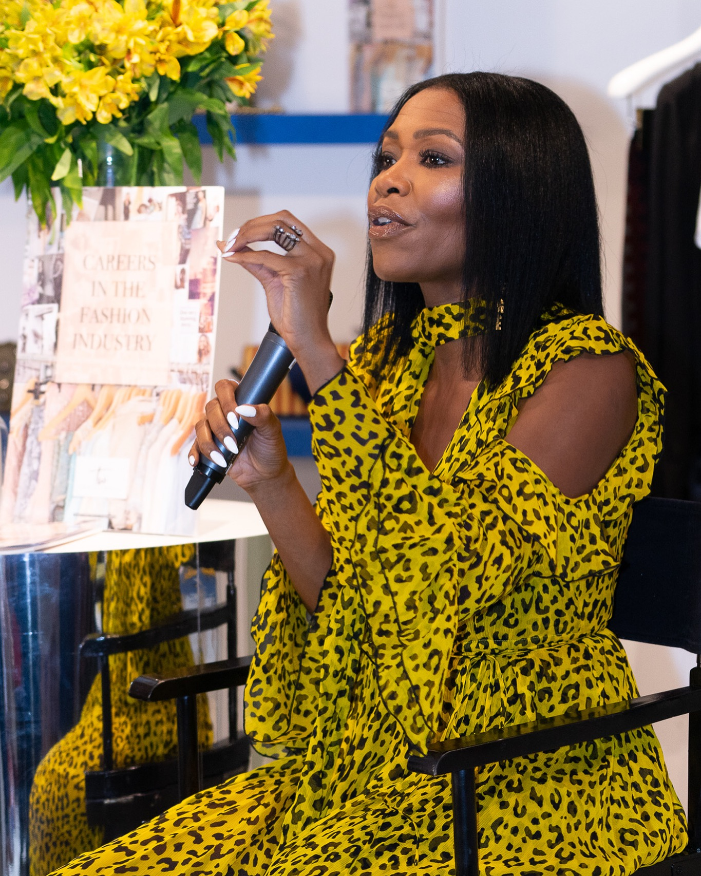 Tamiko speaking at DVF event.JPG