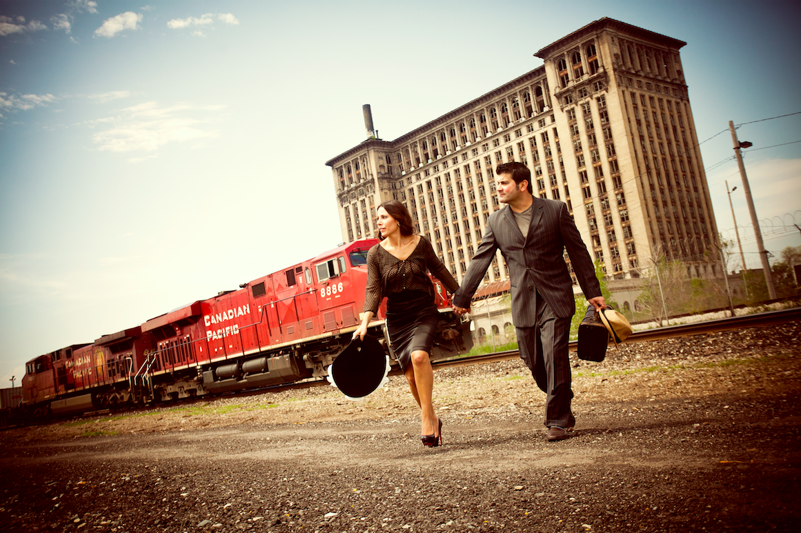This image is by far our favorite engagement photo ever! Doesn't get better than a Bonnie & Clyde theme! #trainstation!