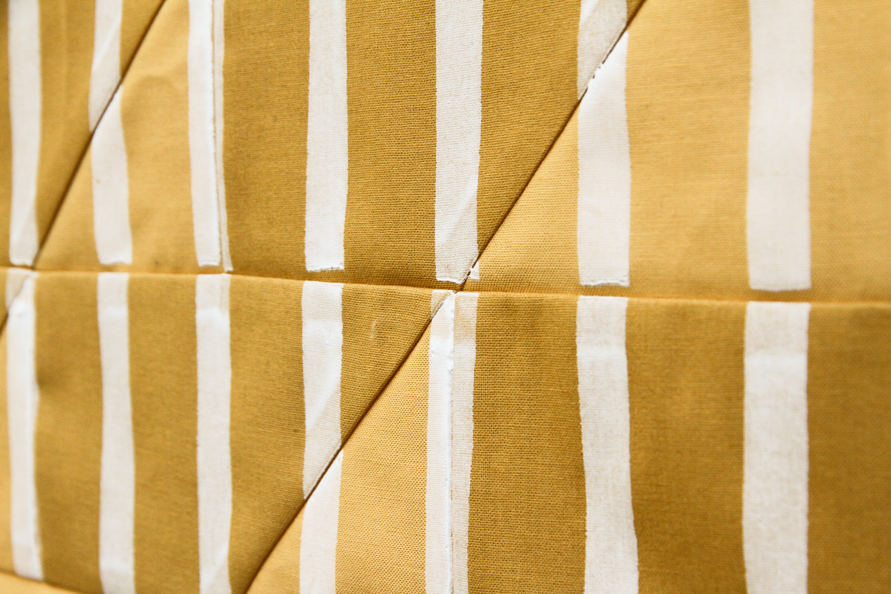 graphic white stripes screen-printed onto a mustard quilt | by Kelsey Boes