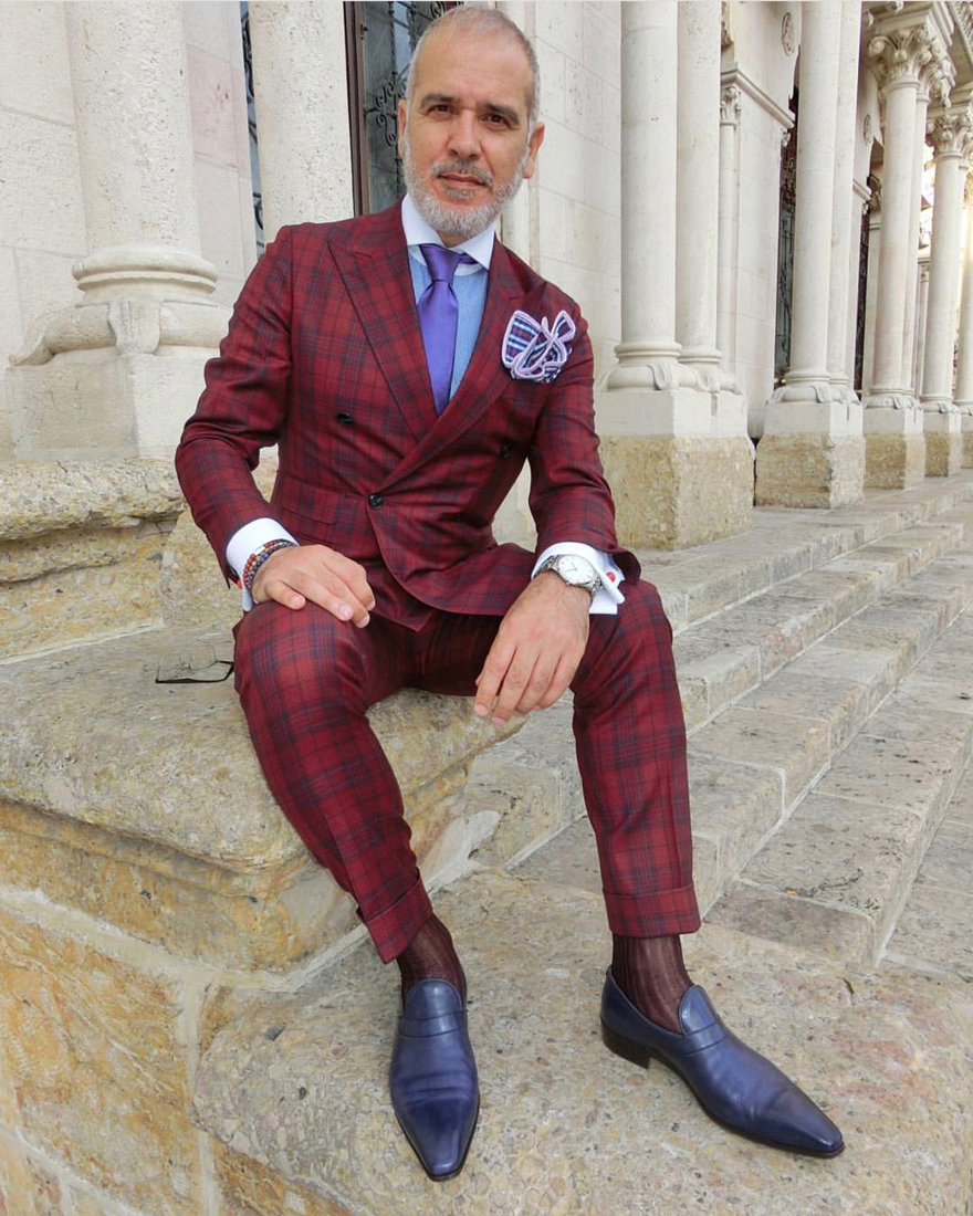 Menswear influencer  The Suited Traveller  wearing a combination of  Baxter&Baxter  bracelets.