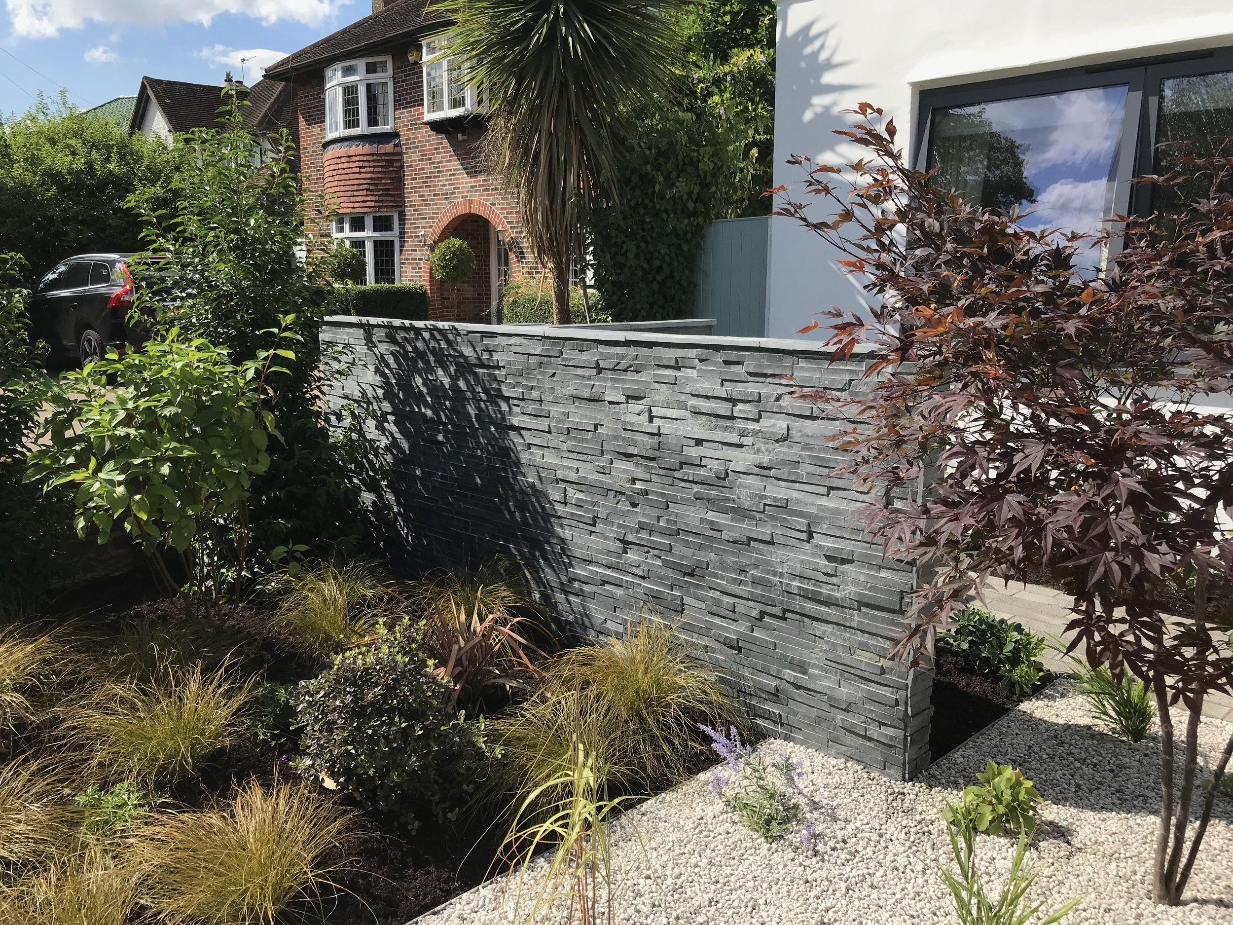 Block wall clad using London stone's Blue black slate, Esher 2018.