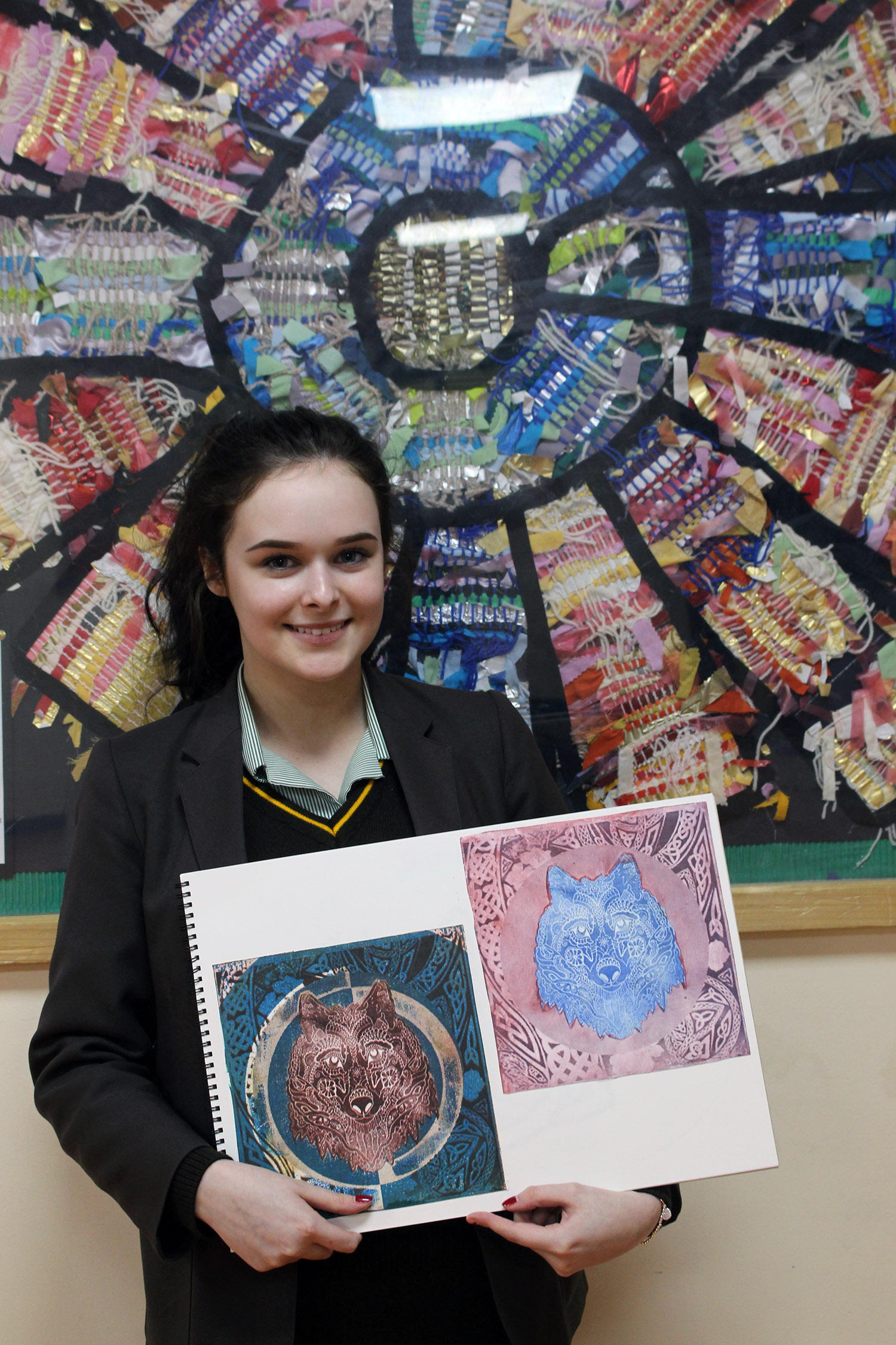 Alisha Whitten with some of her artwork