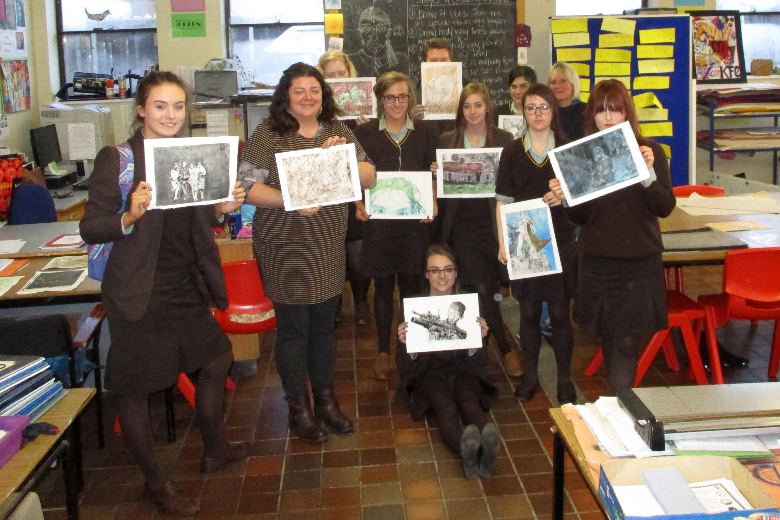 Art teacher Mrs Uprichard is pictured below with the pupils and their prints