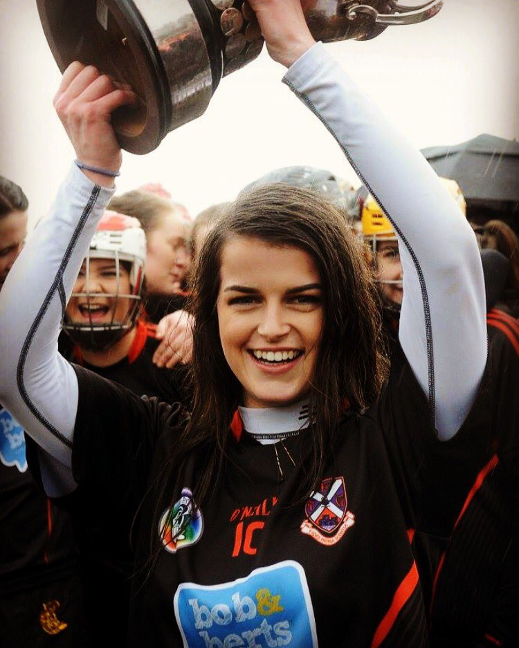 Caoimhe with cup.png
