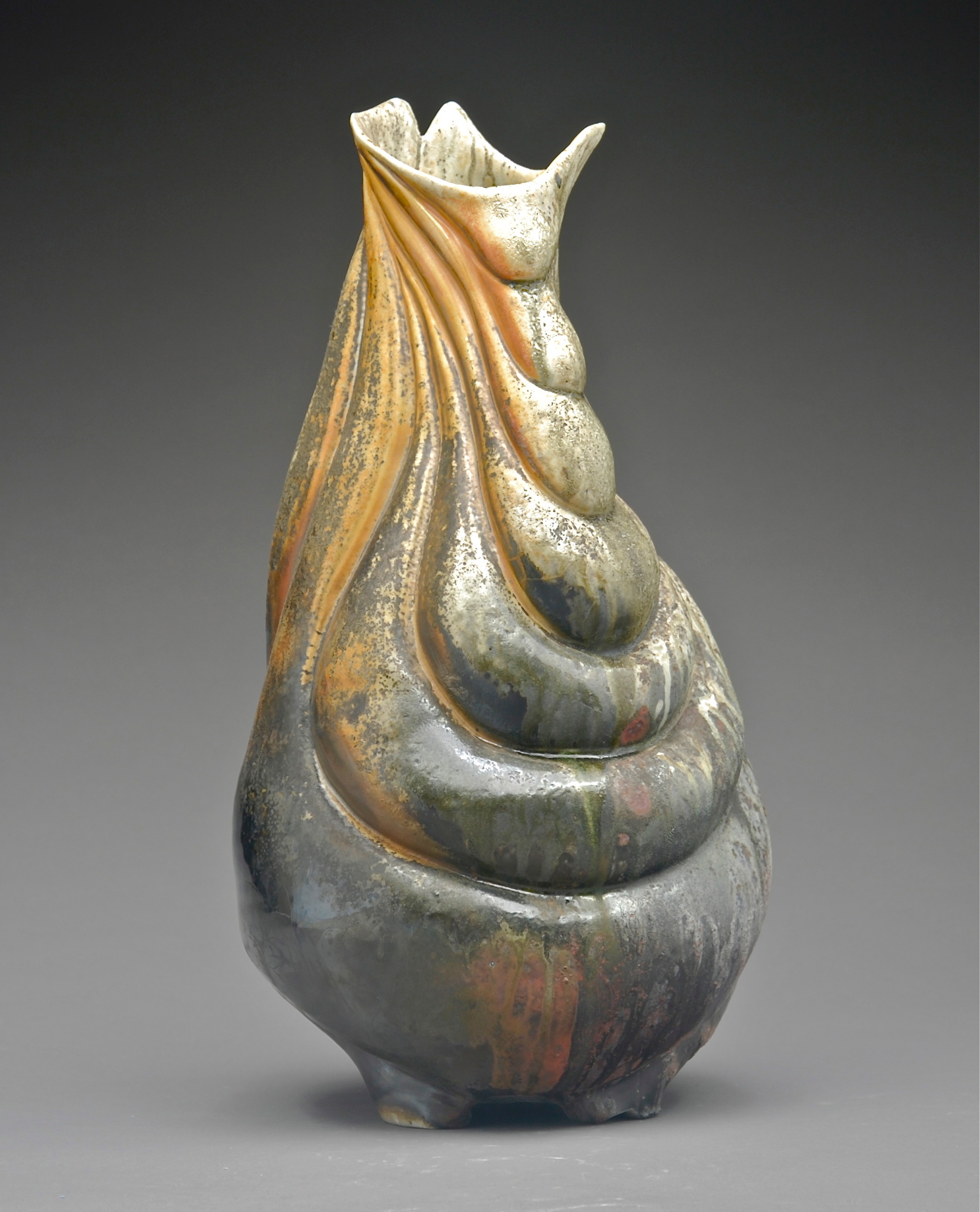 Having been raised in Willis, Hanna's heart sustains deep connection to Floyd, Virginia. Rural living propelled her curiosity of natural growth patterns and cycles of transformation. Her deep-rooted craft heritage kindles an enthrallment for traditional wood firing practices. Subtle flashes of color upon her voluptuous surfaces reveal the velocity of flame through the wood kiln, adding to the variation of each piece. Hanna's work mimics organic growth and fluid movement through her process of altering and carving wheel thrown forms. Her sculptures refer to strength and fragility of nature, imperfection and impermanence. Having lived the past 8 years in the Pacific Northwest, Hanna feels honored to show with the artists who inspired her original intrigue in clay so long ago.