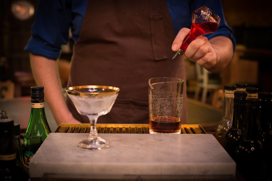 MIXOLOGIST IN ACTION (IMAGE CREDIT: MULTNOMAH WHISKY LIBRARY)