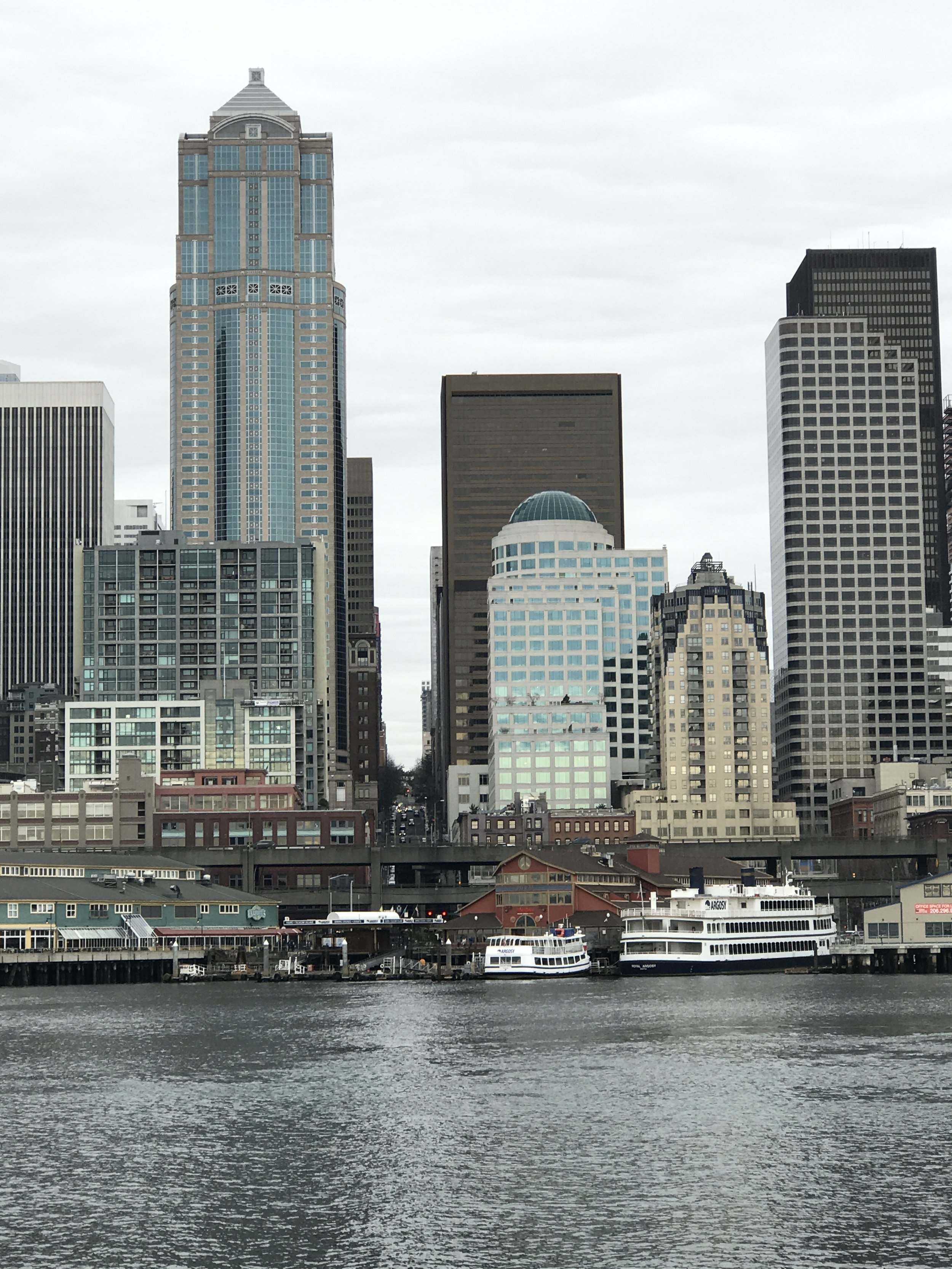VIEW OF THE EMERALD CITY SKYLINE FROM THE HARBOUR