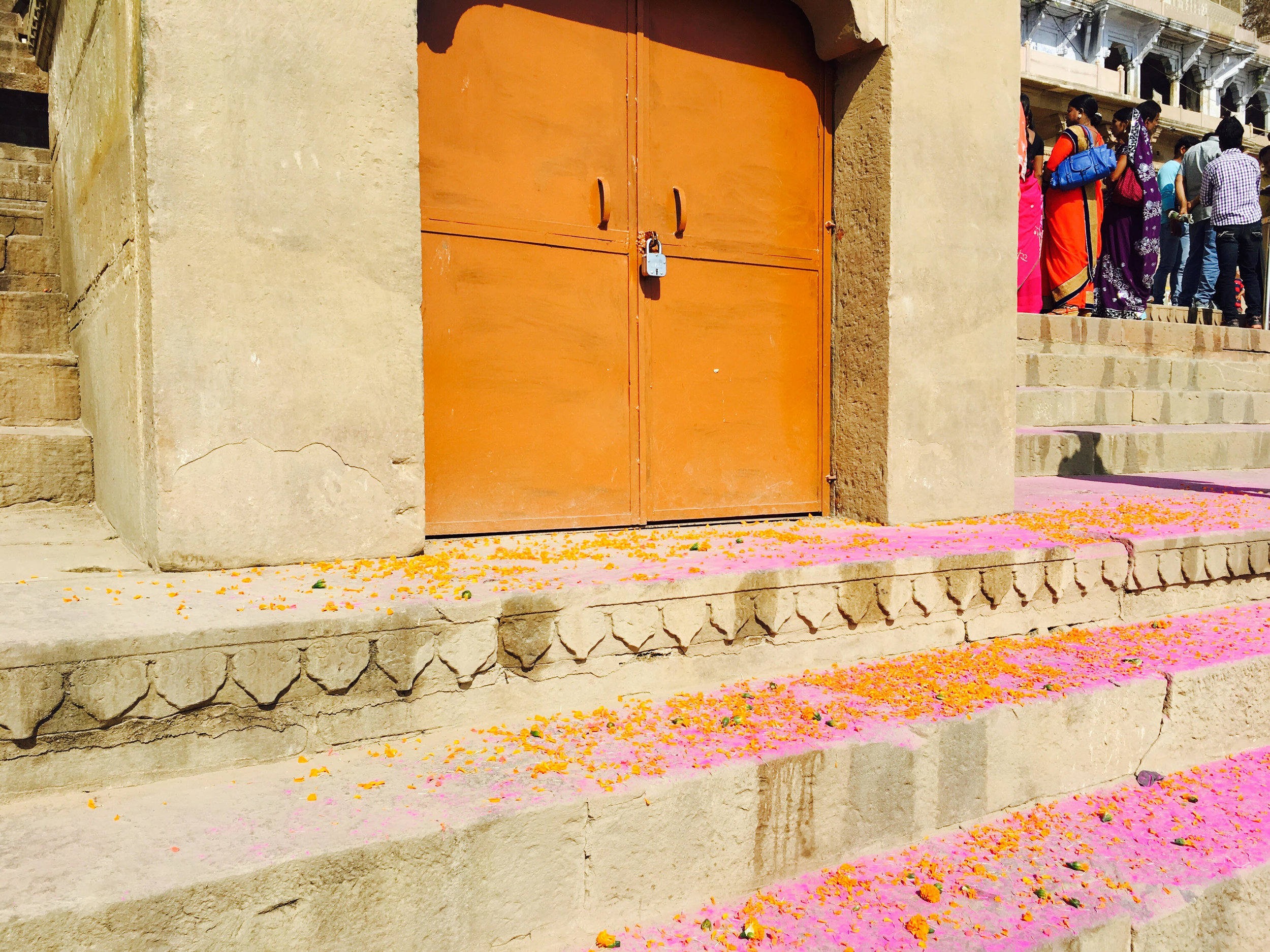Colors on the stairs of a ghat after Holi