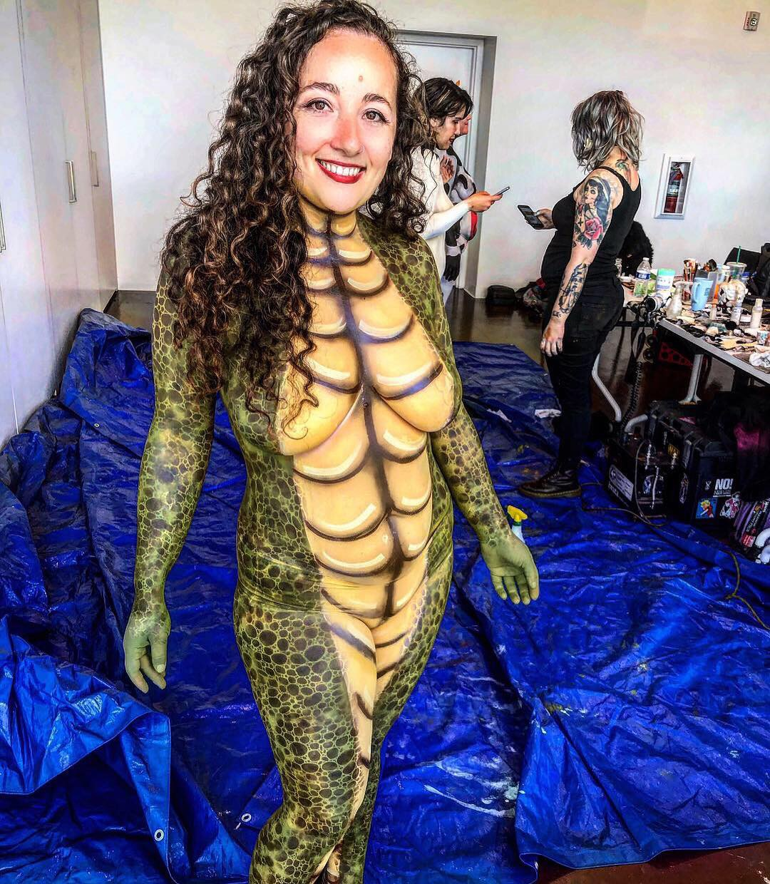 Alligator body paint for PETA.  Body Painter: Hannah Reed