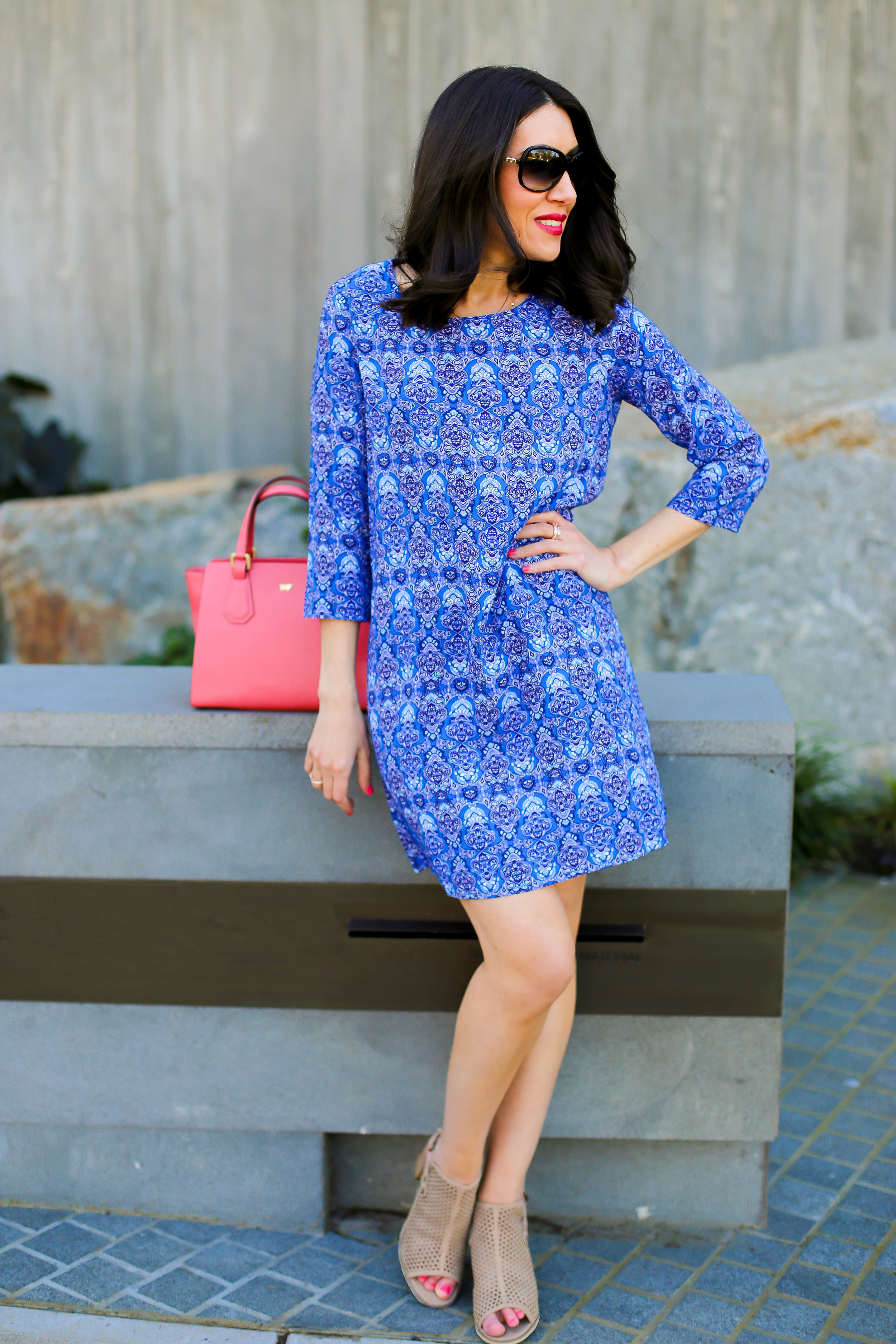 Lisa wears -  Dress  by  Indigo ,  Rings  by  Sophie Catherine ,  Shoes  by  Mollini ,  Bag  by  Braun Buffel  (all available from  Collins234 )