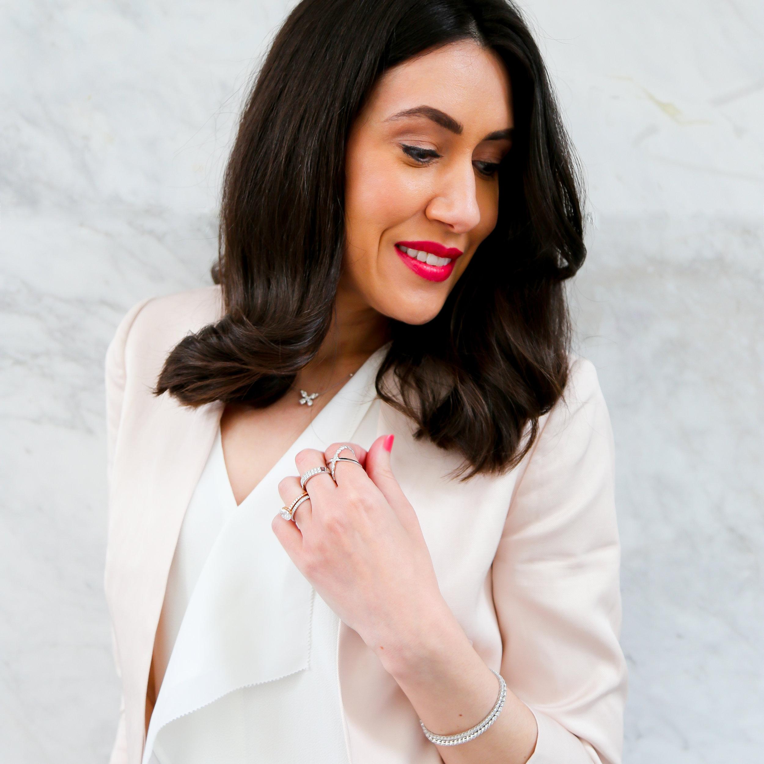 Lisa wears diamond jewellery by T rewarne Fine Jewellers.