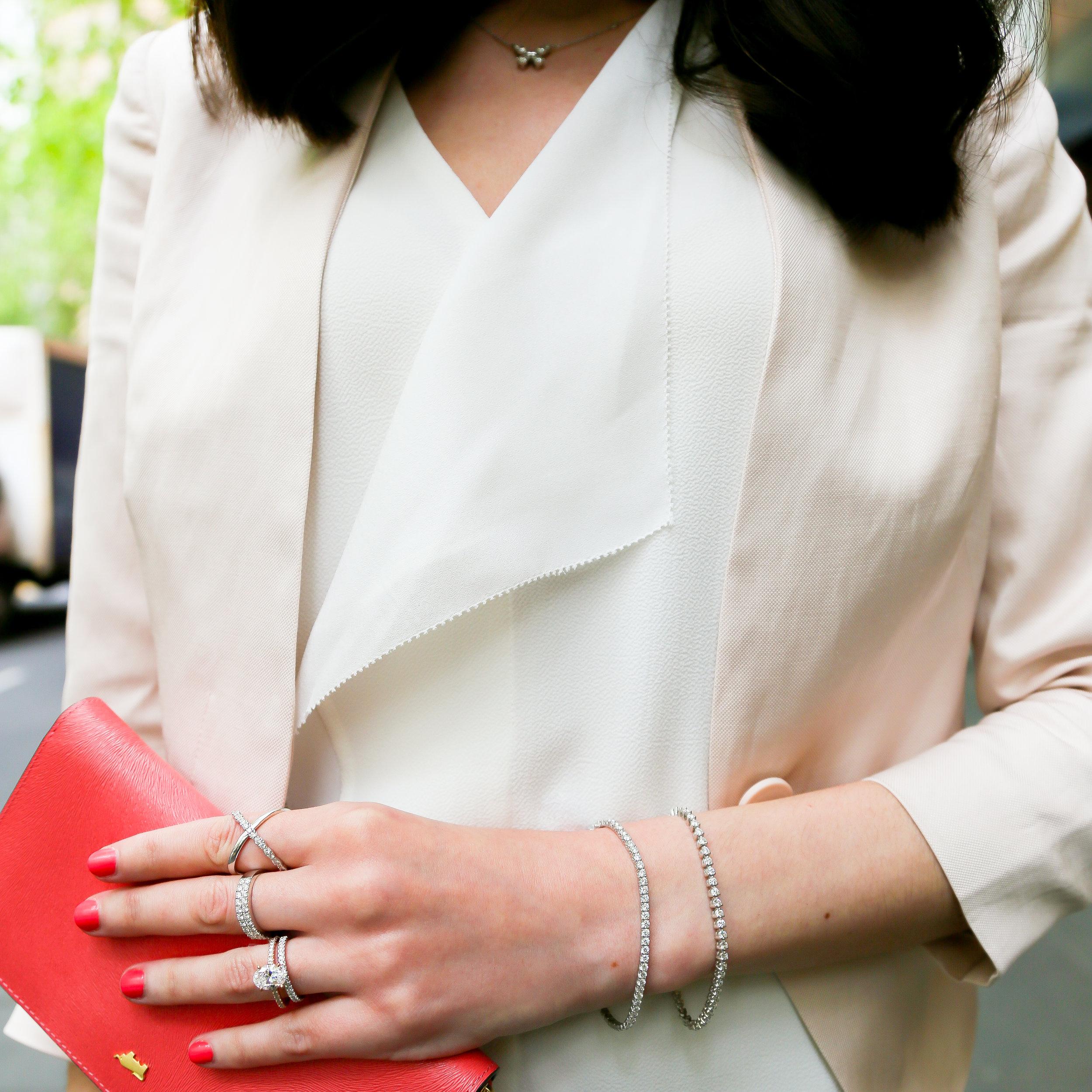 Diamond jewellery by  Trewarne Fine Jewellers ; purse by  Braun Buffel .