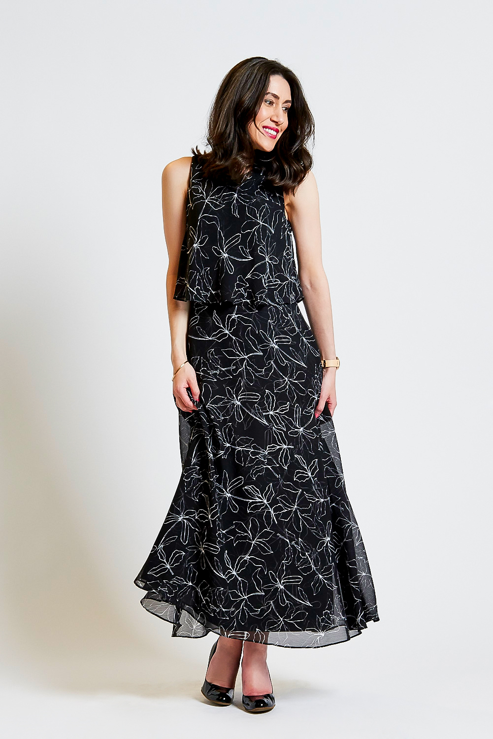 Lisa wears  David Lawrence Floral Double Layer Maxi Dress