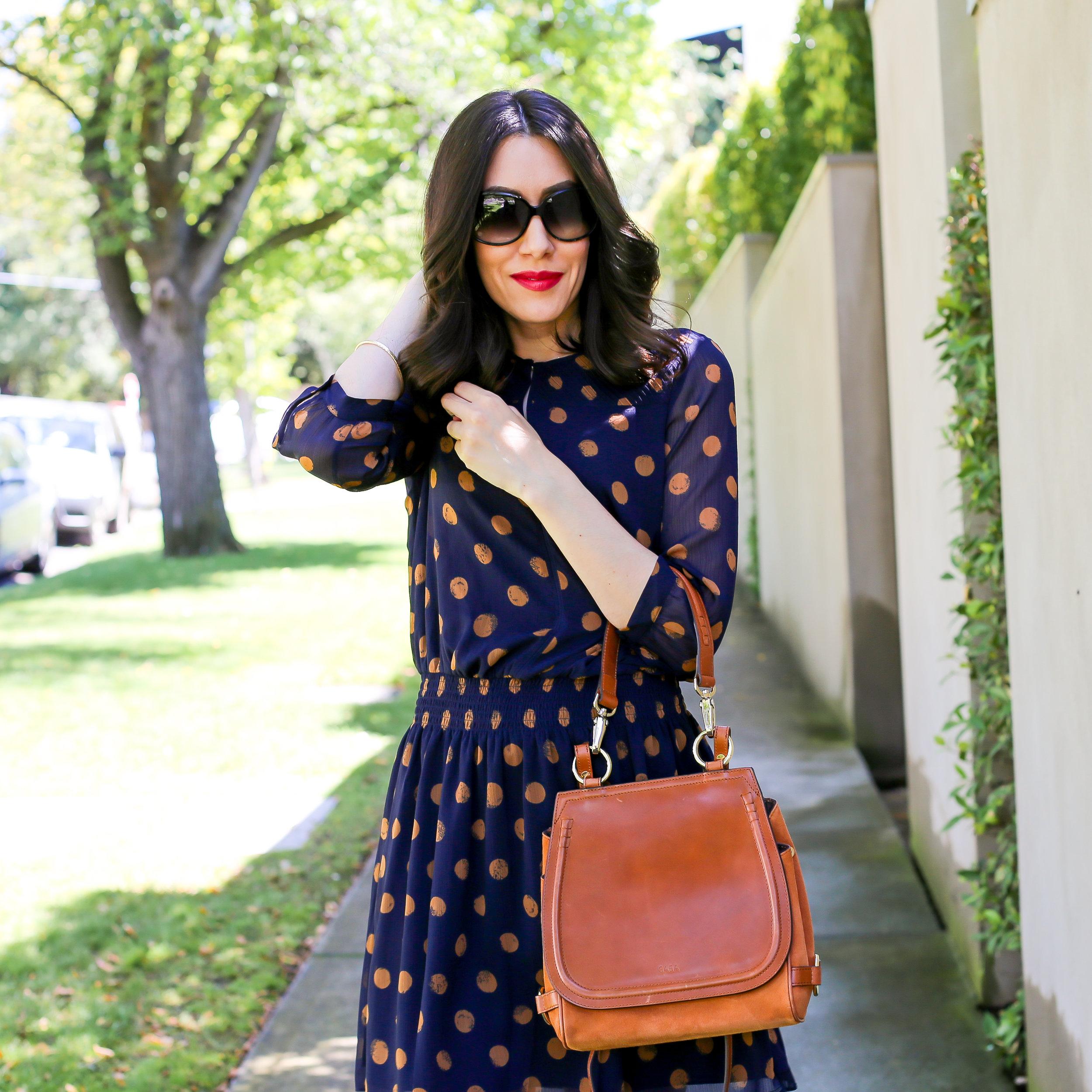 Lisa wears  Saba Odell Spot Dress &  Saba Sara Saddle Bag