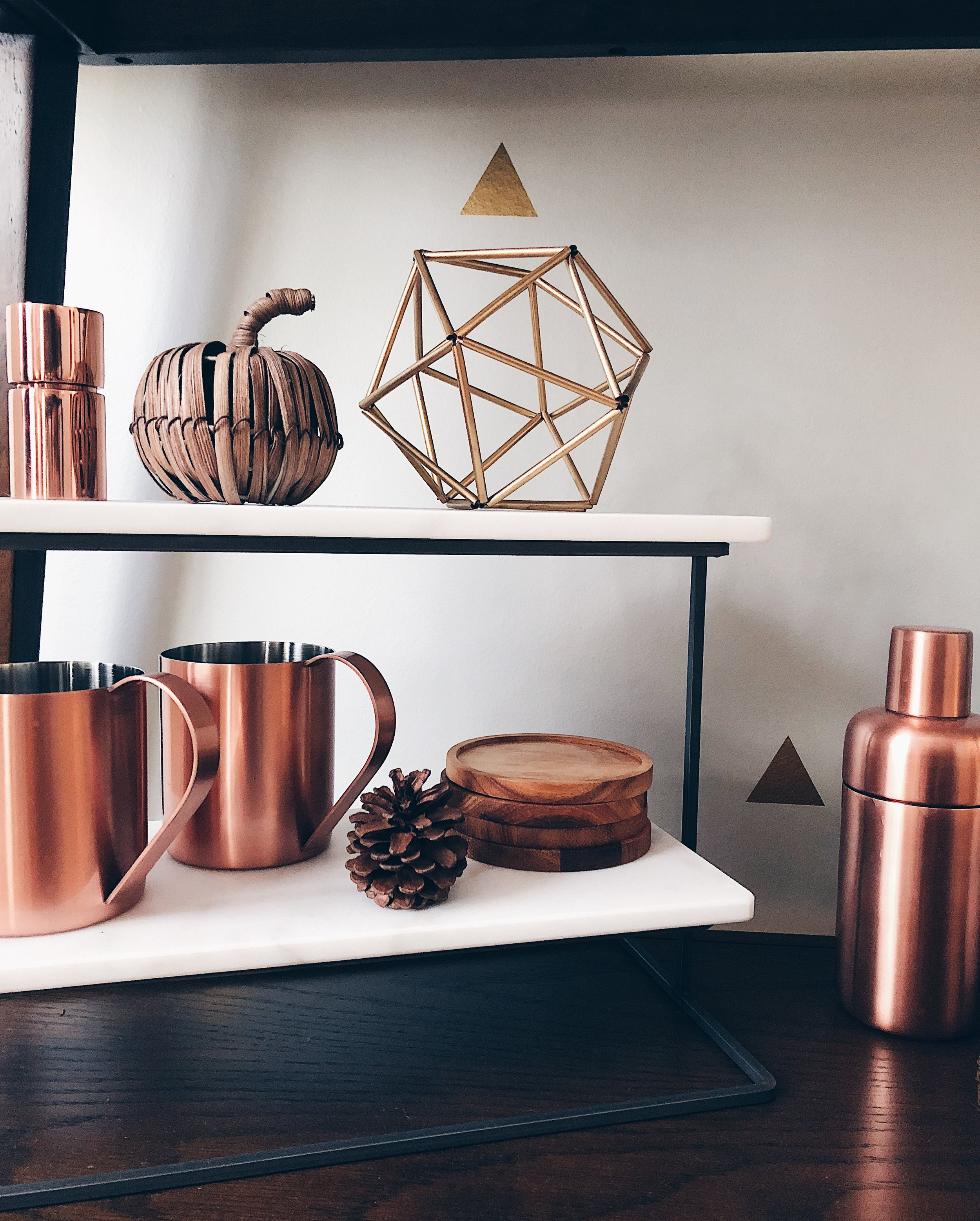 Sources:  Marble Tiered Server  /  Copper Jigger  /  Moscow Mule mugs  /  Copper Cocktail Shaker  /  Acacia Wood Coasters  / Brown Raffia Apple: Pottery Barn / Gold Geo Sculpture: DIY