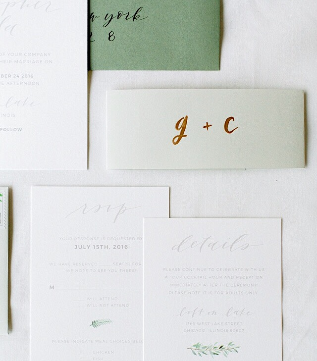 I used a belly band for my own invitations, and hand painted them with our initials. Design by Grace Niu Design, photo by Mayden Photography.