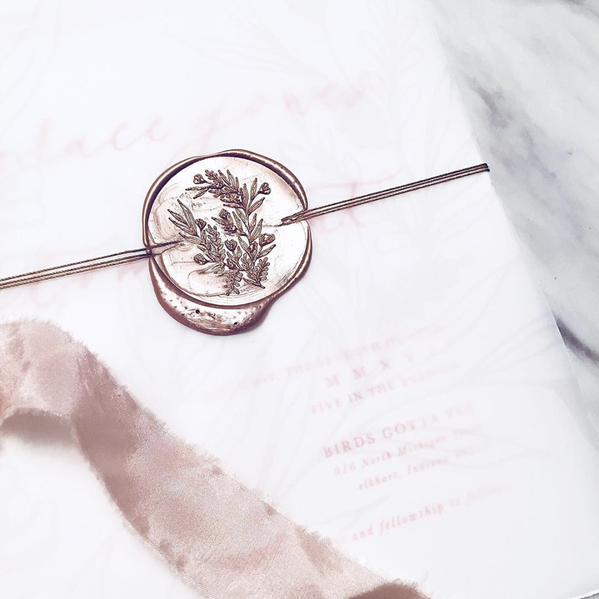 Thin twine finished off with a wax seal. Design, photo and styling by  Sarah B Calligraphy .