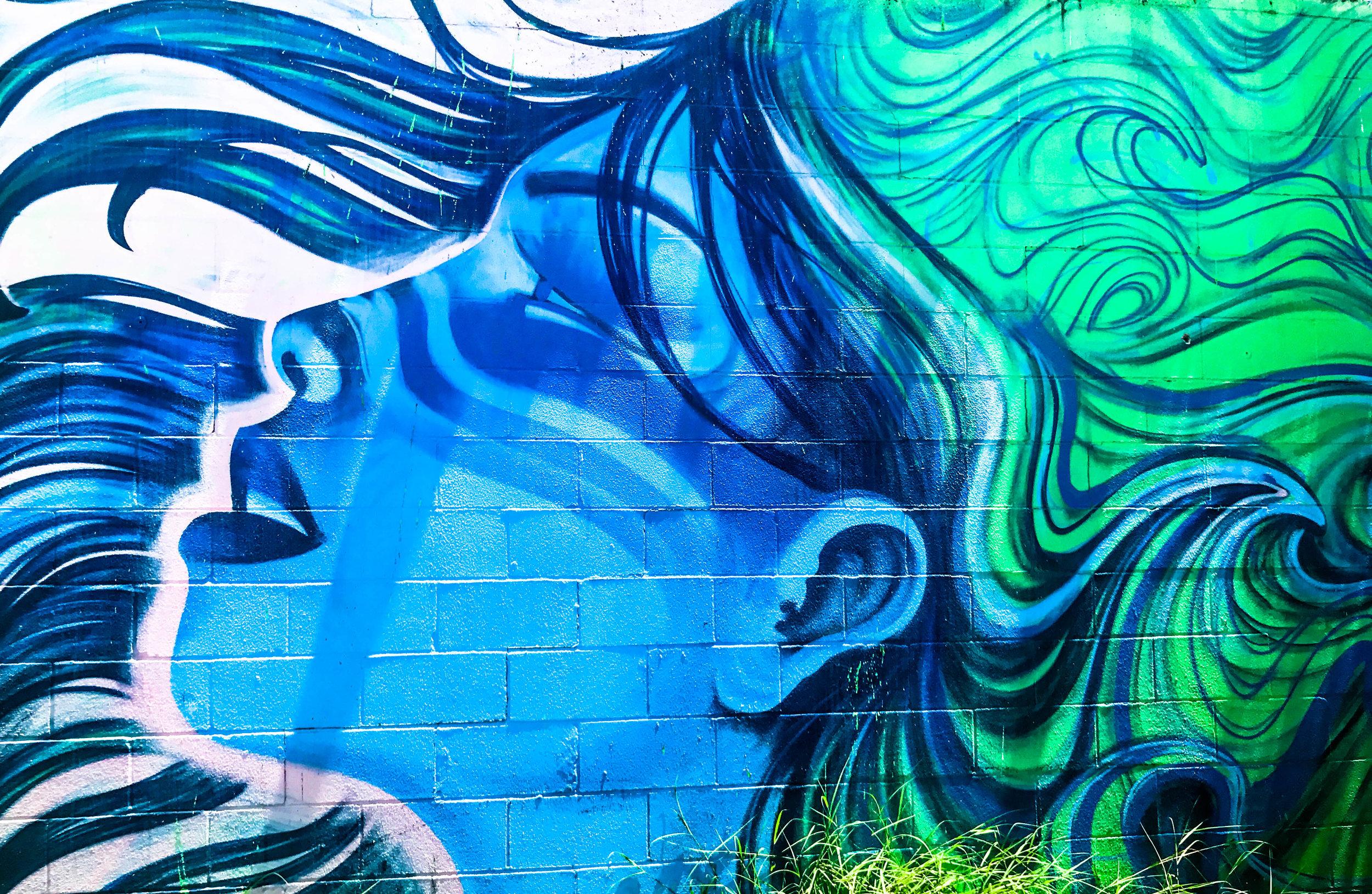 Mural of woman at Las Nieves in San Antonio (artist unknown)