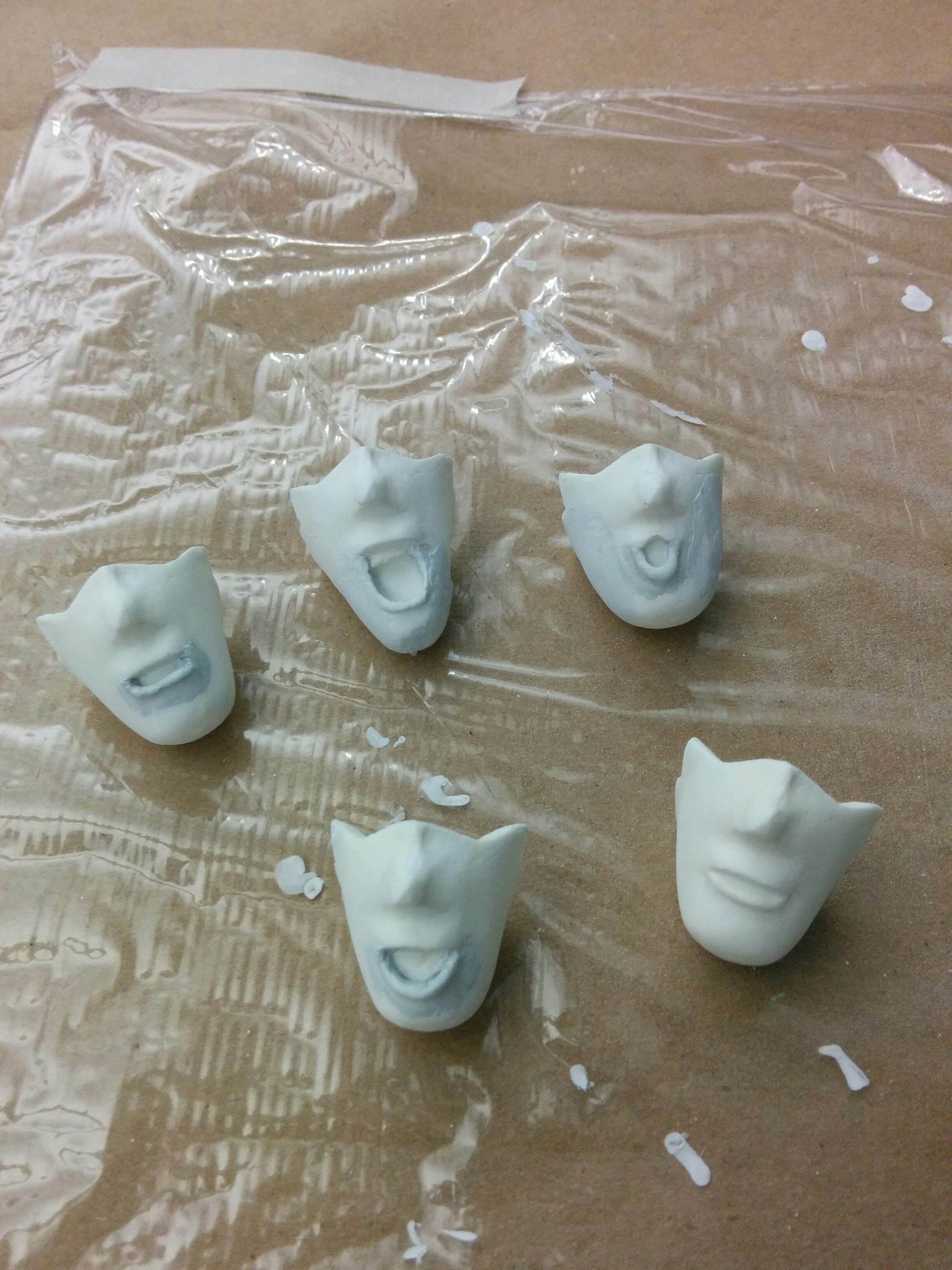 Replacement mouth shapes primed and sanded, prepped for painting.