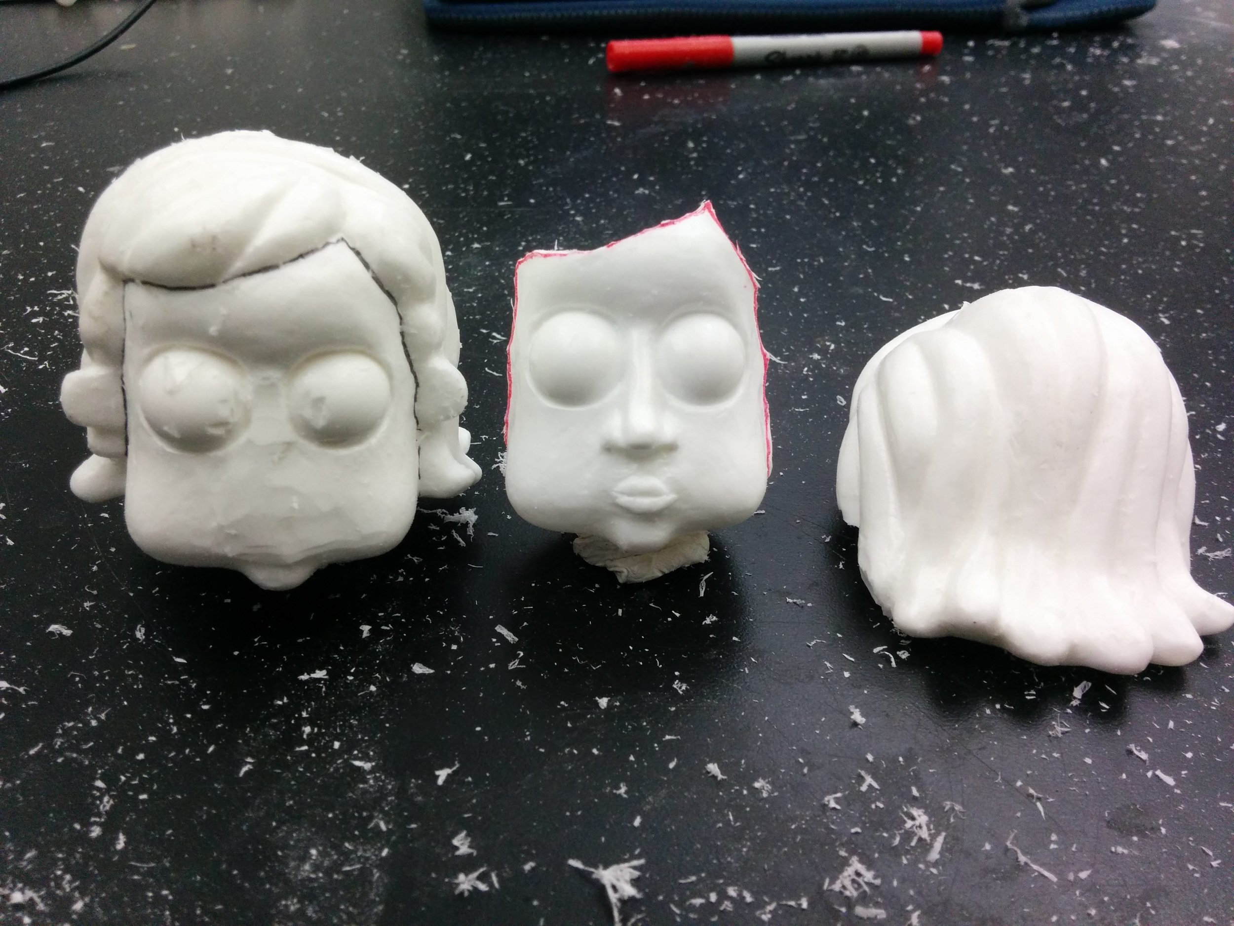 Solid and hollow casts of the head, to form the head block and replacement face.