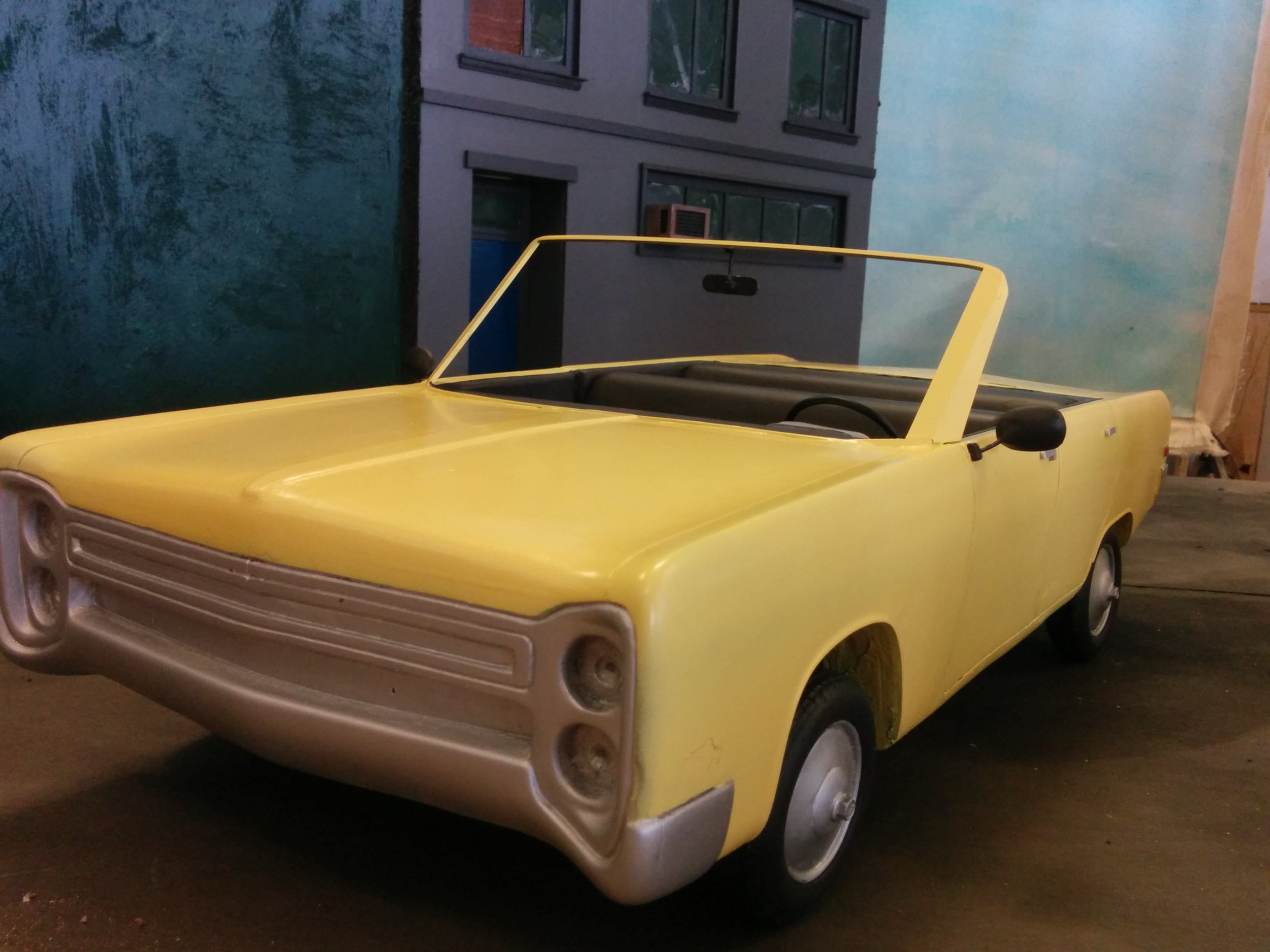 Basla foam model car. I am responsible for building the windshield, repairing the model, rigging the wheels with brass tubing and painting the prop.