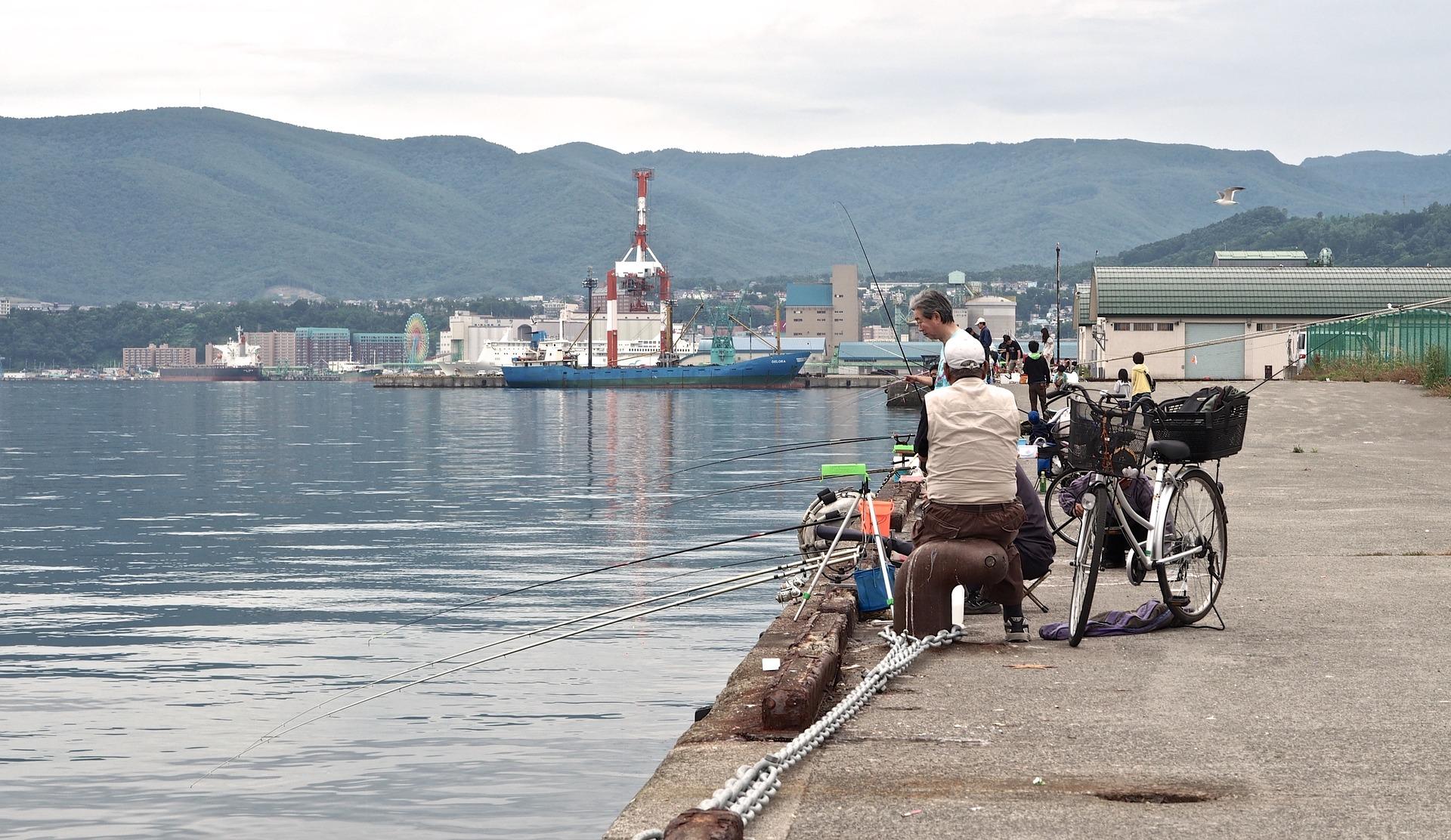 locals fishing at otaru pier, hokkaido