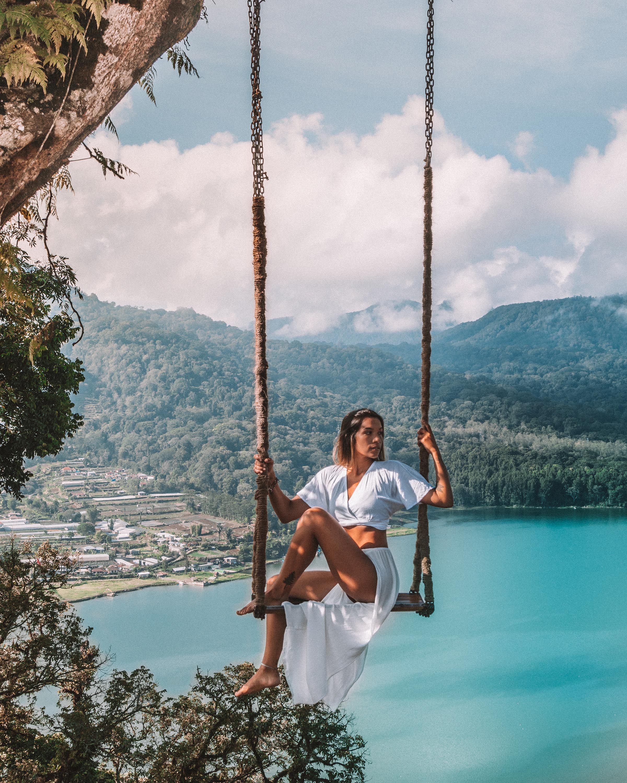 girl swing travel lake view munduk photography beautiful best guide