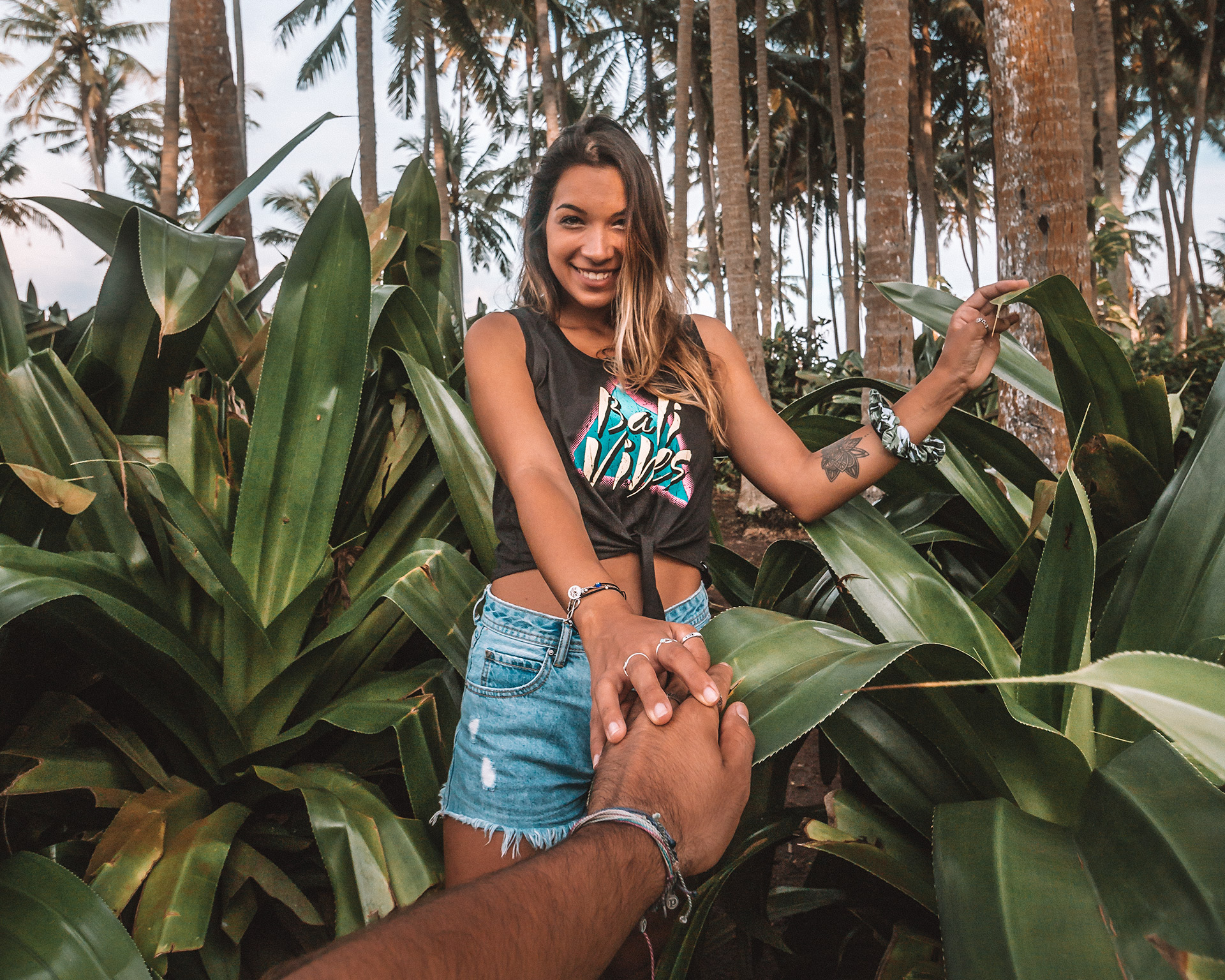 Love Bali tees freeoversea ethical clothing store Bali 1% for the planet palm tree vibes handmade in Bali Indonesia couple photography lush green palm trees pasut beach