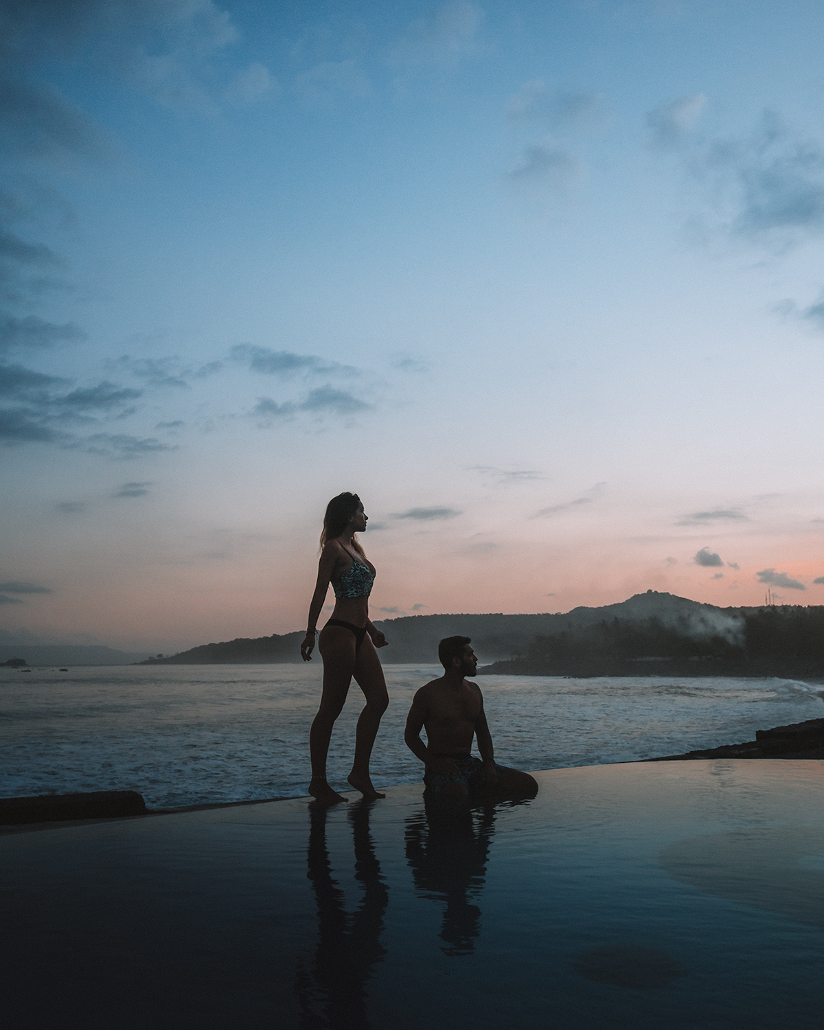 travel couple photographers best hotels infinity pool ocean view beachfront