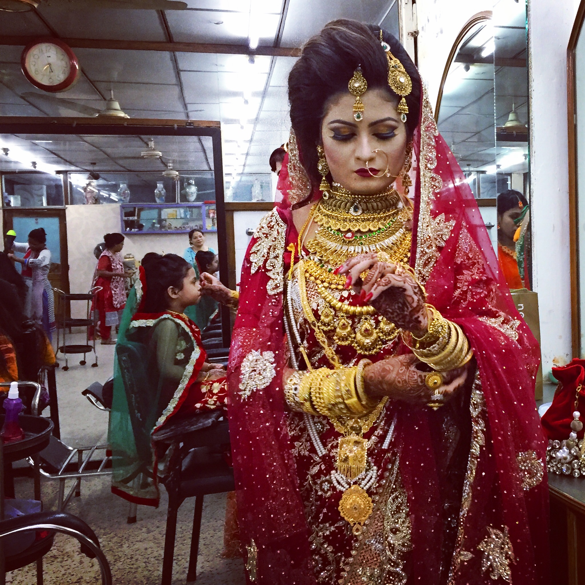 DHAKA | A bride-to-be puts on her gold bangles, the last step in a lengthy process of preparing for her nuptials. July 27, 2016.