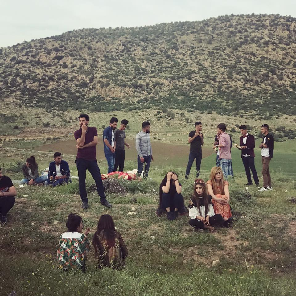 "LALISH | Yazidis while away the afternoon on the hills near the Lalish temple, where many came to mark Charshama Sor (""Red Wednesday""), the celebration of Yazidi New Year which occurs in April. April 18, 2018."