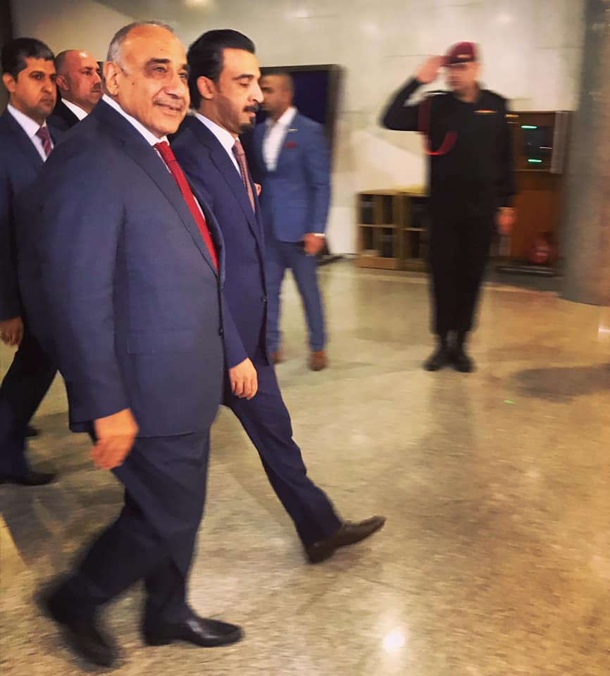 BAGHDAD | Adil Abdul Mahdi, now confirmed as Iraq's fifth prime minister since the fall of Sadaam, walked into the parliament building to present his cabinet lineup last night. MPs approved 14 out of 22 ministers. High profile positions including defense and interior have yet to be confirmed. Expect more political wrangling to come. Our story:  https://www.iraqoilreport.com/news/adil-abd-al-mahdi-takes-power-as-government-begins-to-form-33481/ . October 25, 2018.