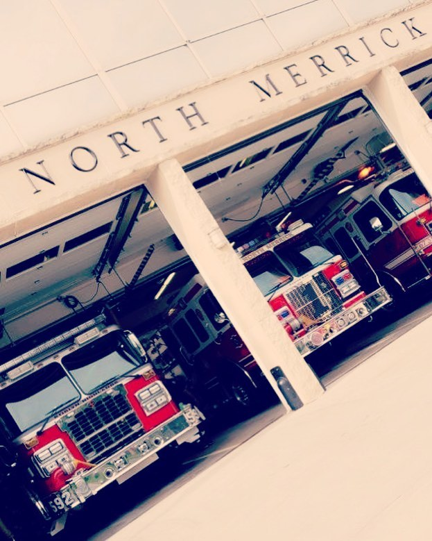 Roslyn Highlands Engine 592 standing by for North Merrick FD, while they attend the 6th Battalion parade.