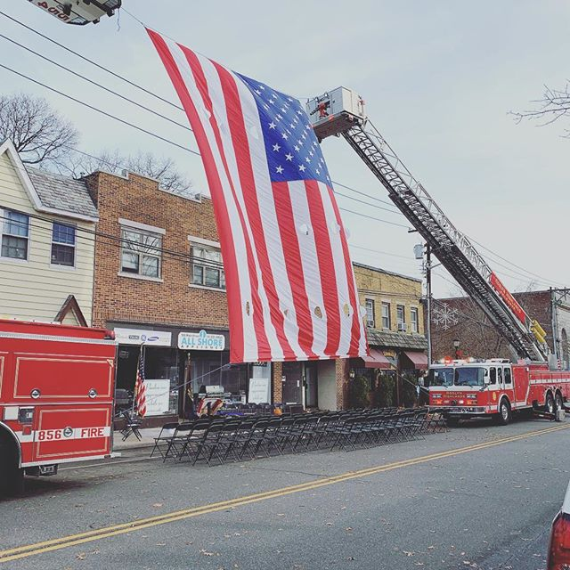 Providing a flag arch for plaque dedication and memorial service for a fallen brother.  Robert H. Dayton, known as Bobby, was a Lieutenant of Flower Hill Hose Co. #1. who died, on duty, November 26, 1988.  While commanding a search and rescue team at an apartment fire on Main Street, he became trapped and ran out of air. Due to the intense heat and smoke, repeated efforts to rescue Lieutenant Dayton were unsuccessful. He was later pronounced dead at St. Francis Hospital. The Nassau County Police Homocide Squad and Fire Marshall's Office later ruled the cause of the fire to be arson.  Lieutenant Dayton attended Schreiber High School and later studied computers at Nassau Community College. He joined Flower Hill Hose Co. #1 at 18 years old. In addition to serving as a volunteer in Port Washington, he was also a professional firefighter with the Fire Department, City of New York, assigned to Engine Company 287 in Elmhurst, Queens. He was posthumously promoted to Captain of Flower Hill Hose Company #1.  The Port Washington Fire Department continues to mourn the loss of Captain Dayton. In 2010 the Town of North Hempstead renamed Haven Avenue, where Flower Hill Hose Co. #1 is located, Captain Robert H. Dayton Way.