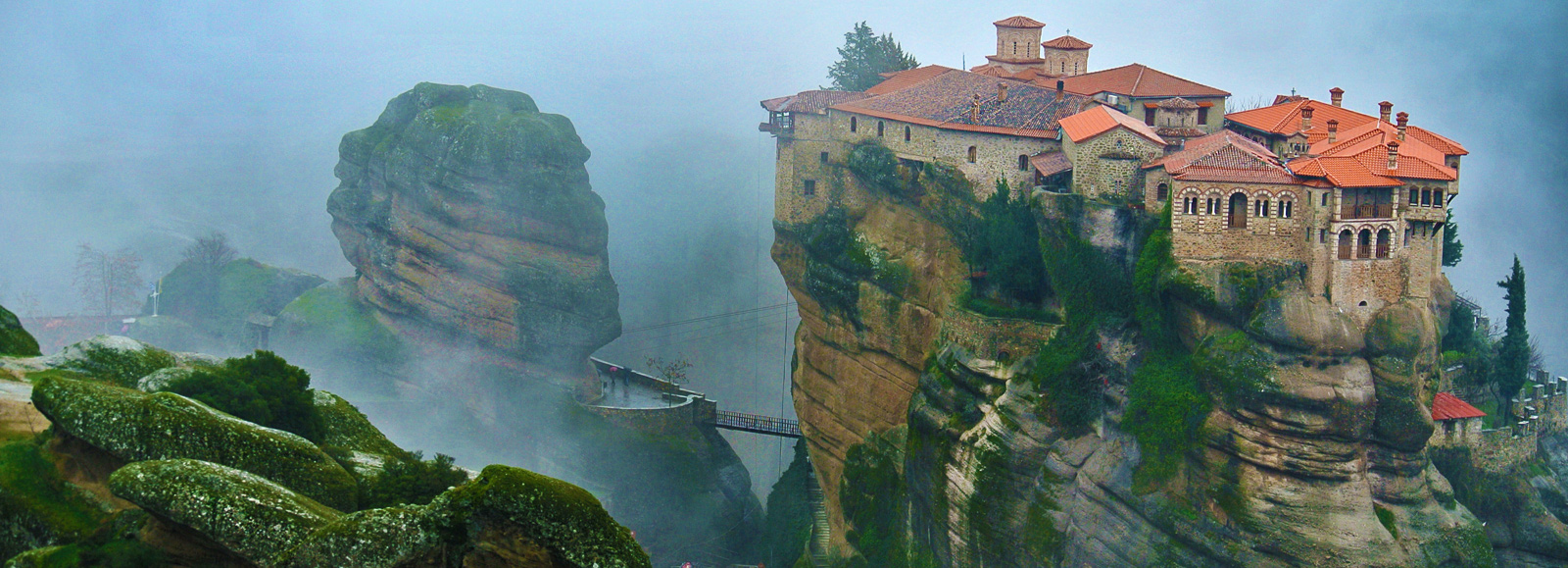 Monastary perched high on rocks in Italy