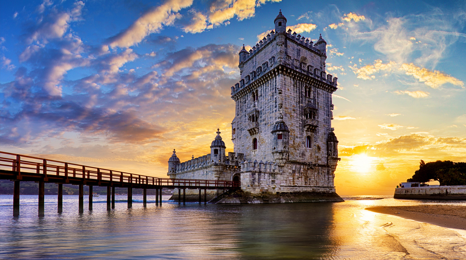 Old stone castle on water at sunset