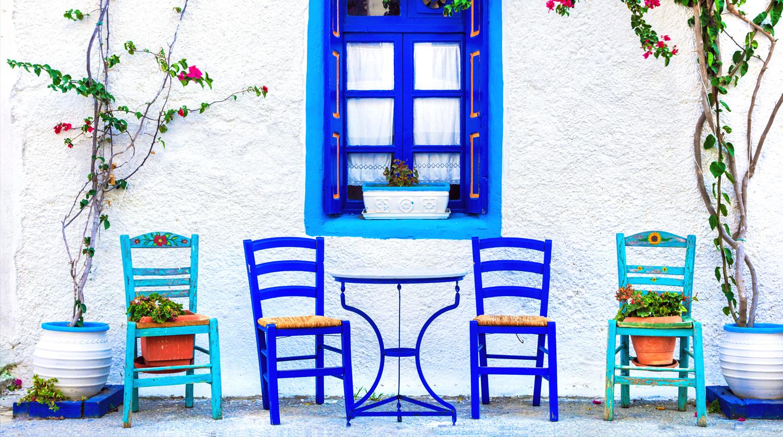 Greek street scene with blue chairs