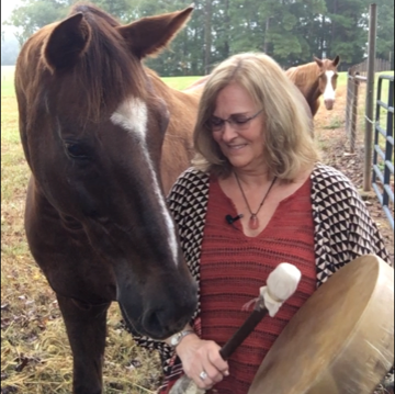 Mary Ellen Connett drumming with EquiHeart partners, Sven and Sunny