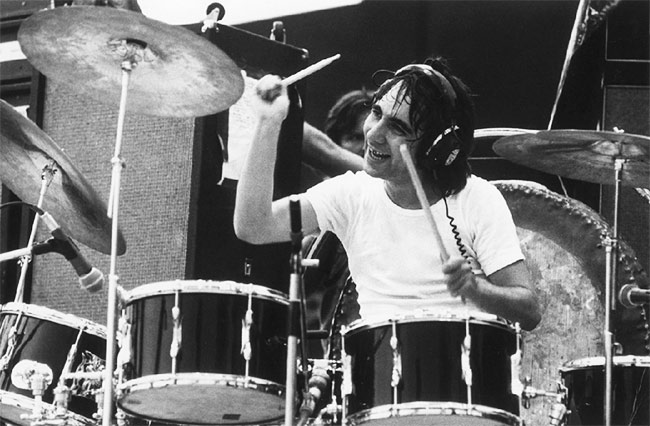 Keith Moon on-stage with The Who in the early 1970s. The headphones most likely indicate he was playing to a backing track - Image Credit: Michael Putland