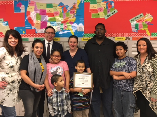 Pictured (front center) Devin Williams, awardee, with Nicole and Andrew Williams, his sister and younger brother. In the back row (from left) are Rebecca Kasavich of Copies at Carson; Elizabeth Homlish, first grade teacher; Richard Ernsberger of Behrend and Ernsberger Attorneys at Law, sponsor of the award; Andrea Williams, mother; Jamaine Williams, father; Brandon Williams, older brother; and Dana Boesenberg, Phillips principal.