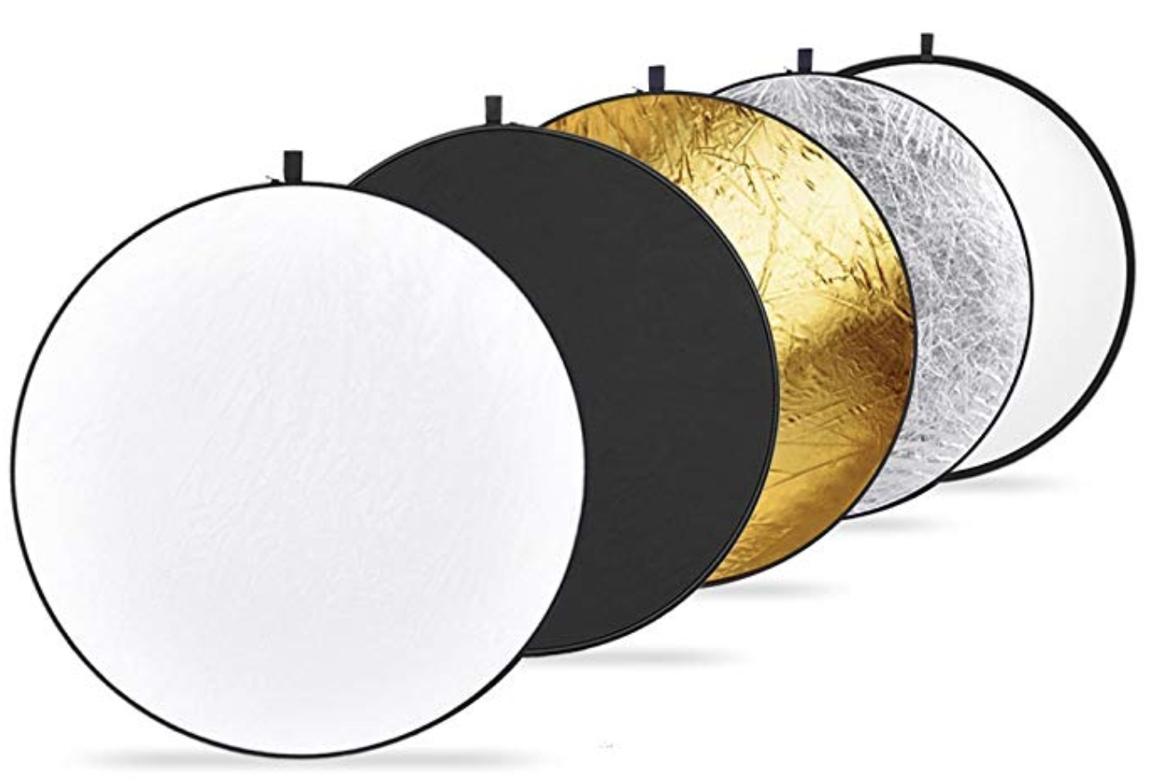 Neewer 43-inch 5-in-1 Collapsible Light Reflector - Translucent, silver, gold, white and black with a bag for storage.