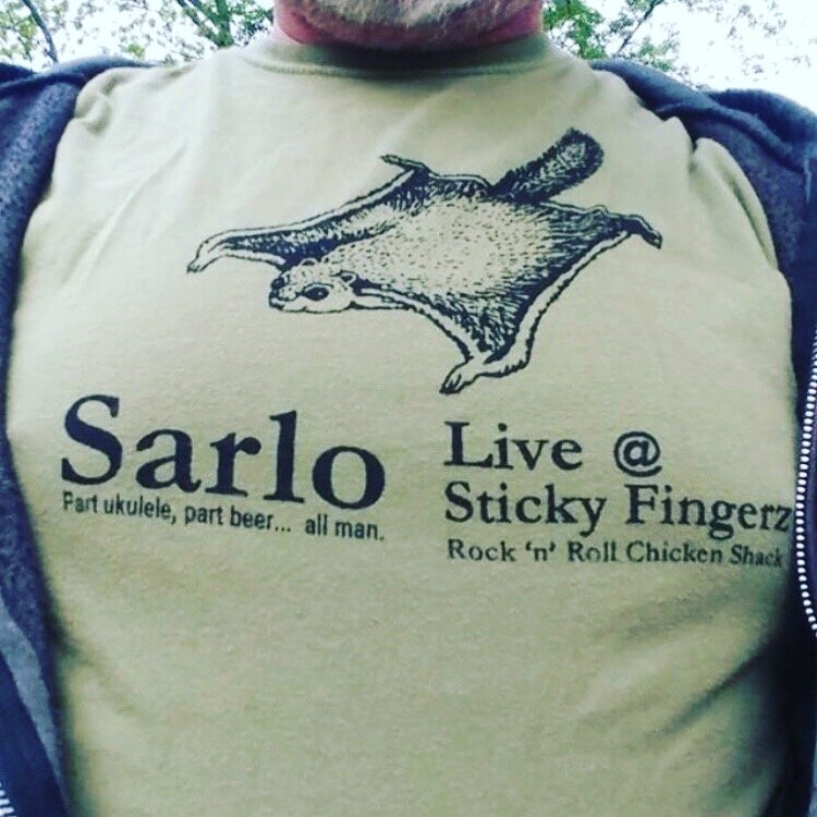 "The infamous ""Flying Squirrel"" t-shirt with my name and a regular gig I did for a hot minute in downtown Little Rock. I handmade a couple dozen of those shirts, and they still pop up on occasion."