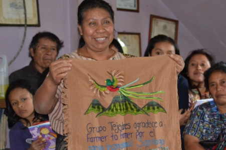 Rosa Consigua, presenting an embroidery to Farmer to Farmer thanking us for the support. .JPG