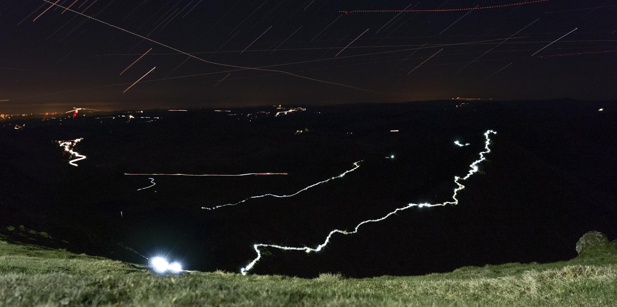 Runners climbing over Y Lliwedd