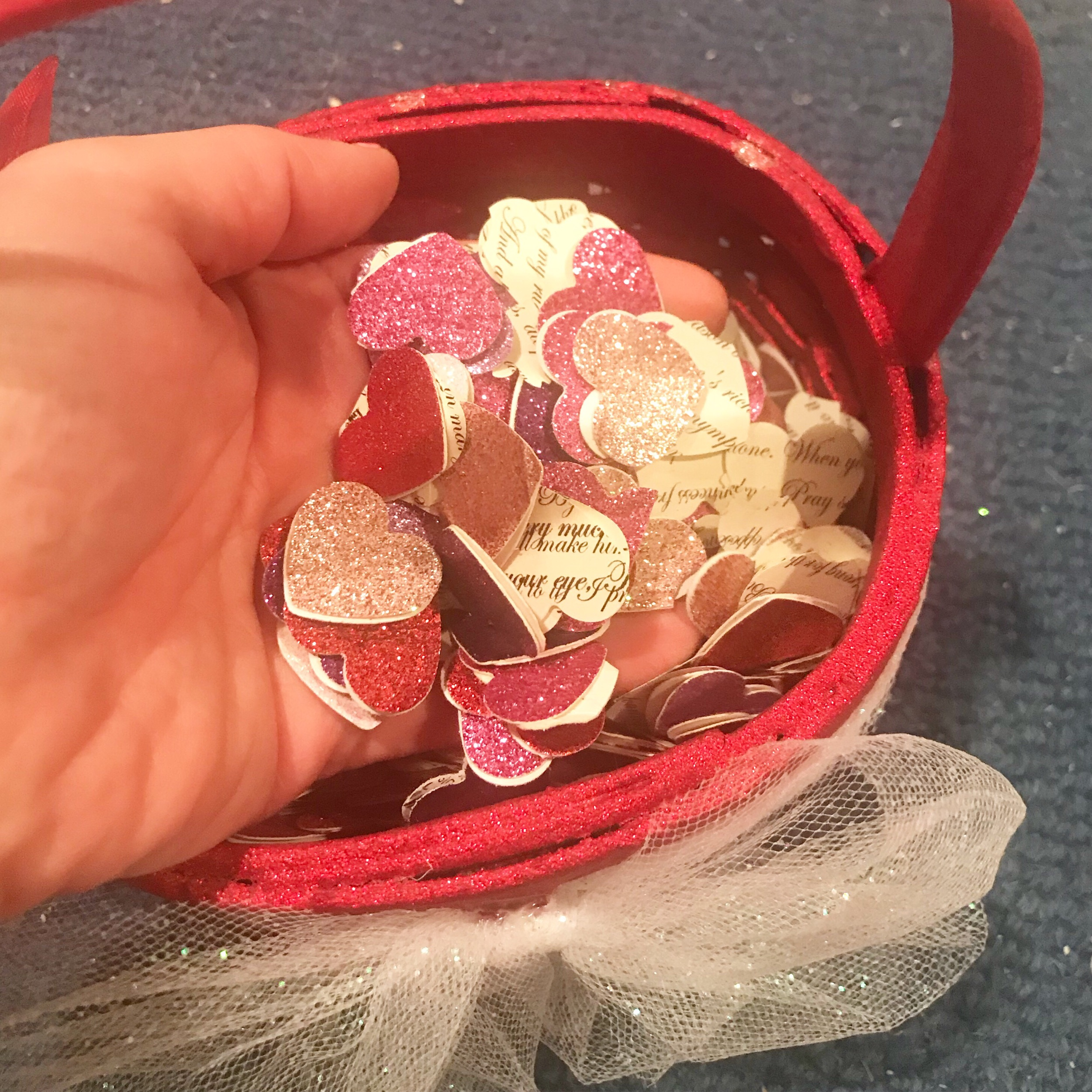 Glitter and Shakespeare Heart scatter! I also painted the flower girls' baskets bright sparkly red.