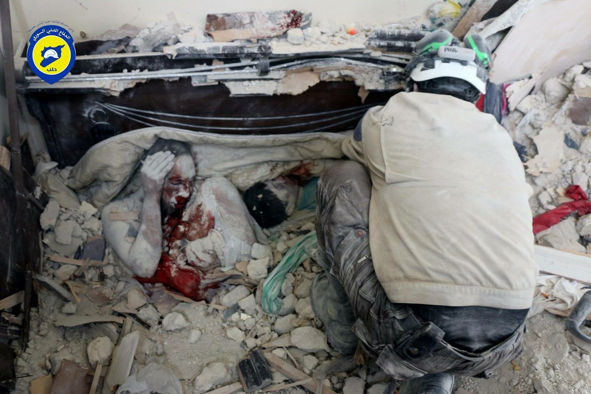 A man and and a child are buried as a result of bombings in civilian areas in Syria.