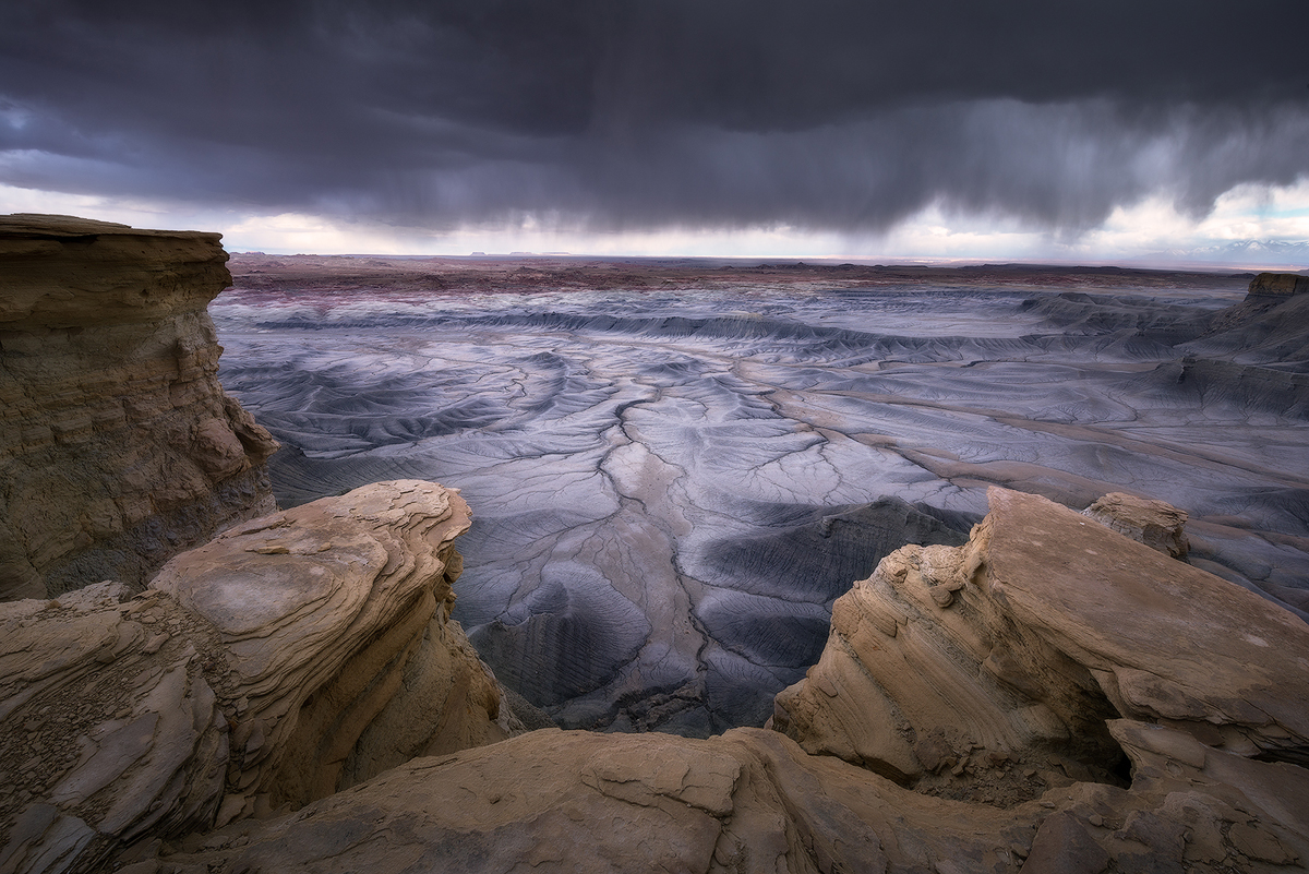 """Exile in Guyville"" -- A line of strong rain and wind moves though a section of otherworldly badlands.   Nikon D800e, Nikon 14-24mm f/2.8 @ 14mm"