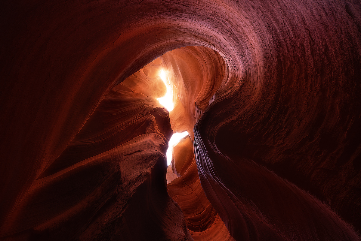 """Navajo Spirit"" -- swirling sandstone patterns carved by centuries of flash floods frame a daylight opening in Canyon X  Nikon D800e, Nikon 14-24 @ 16mm.  Multiple exposures for depth of field and to reduce glare"